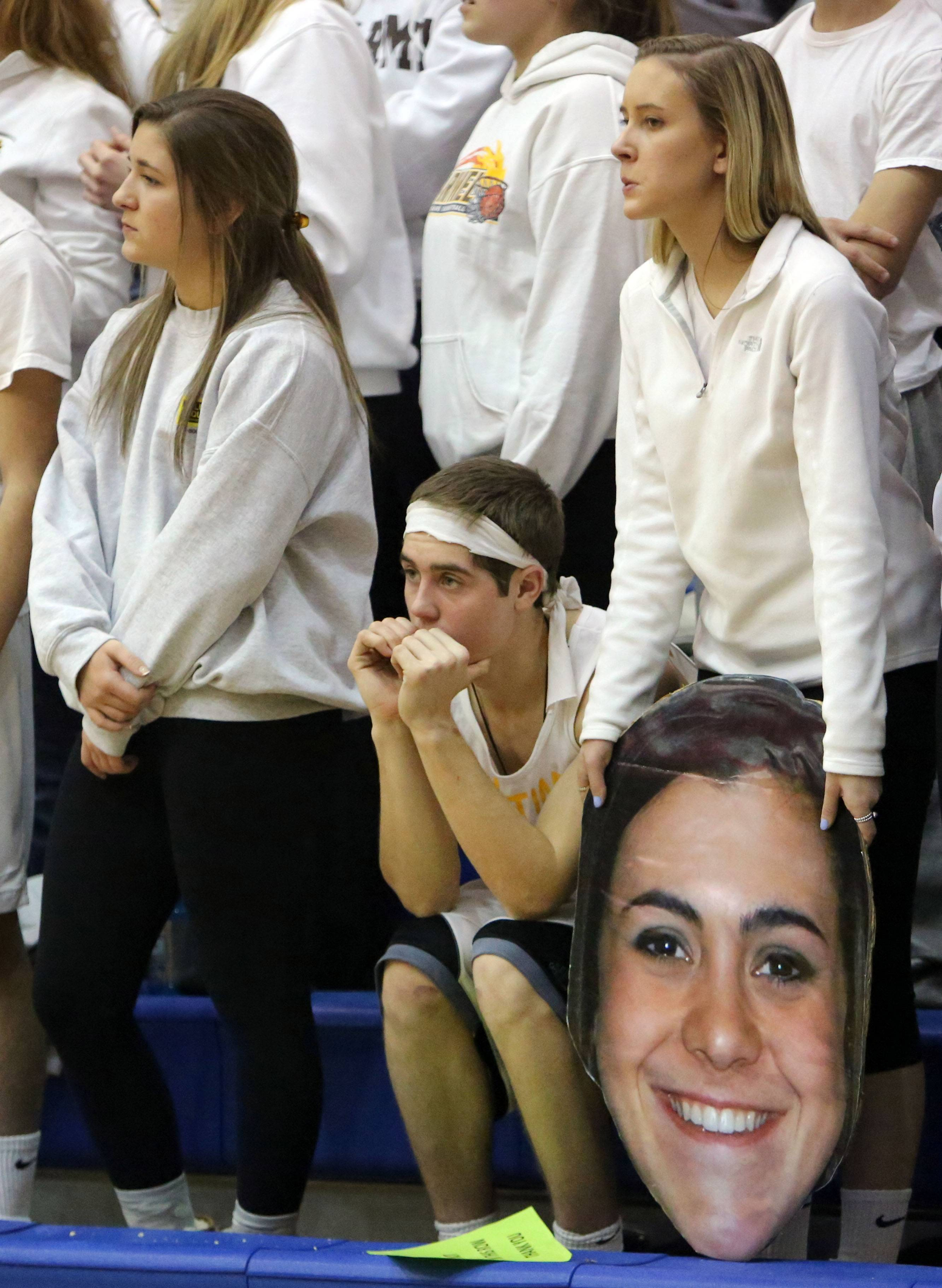Carmel fans react after the game.