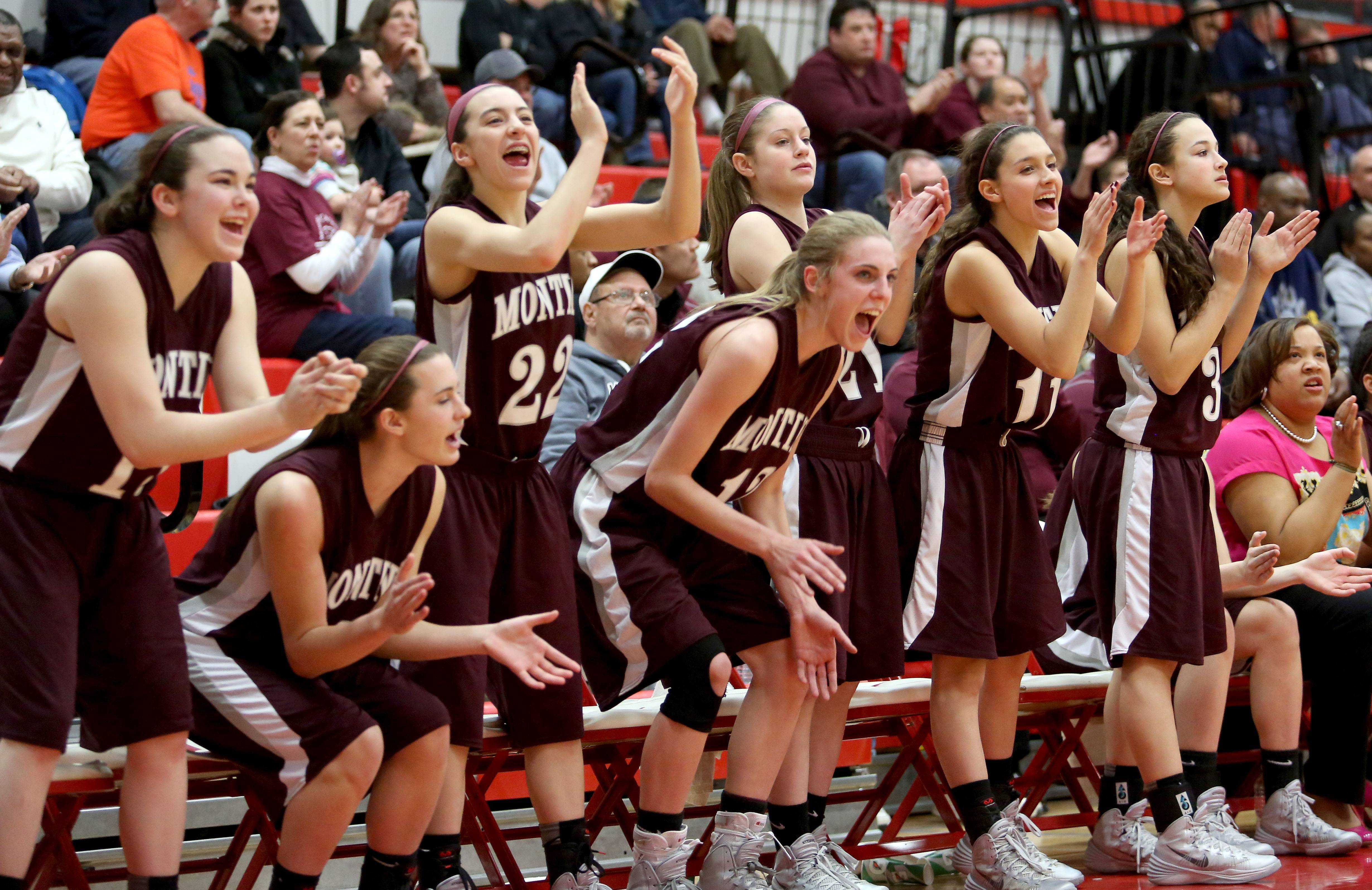 Players on the Montini bench celebrate.
