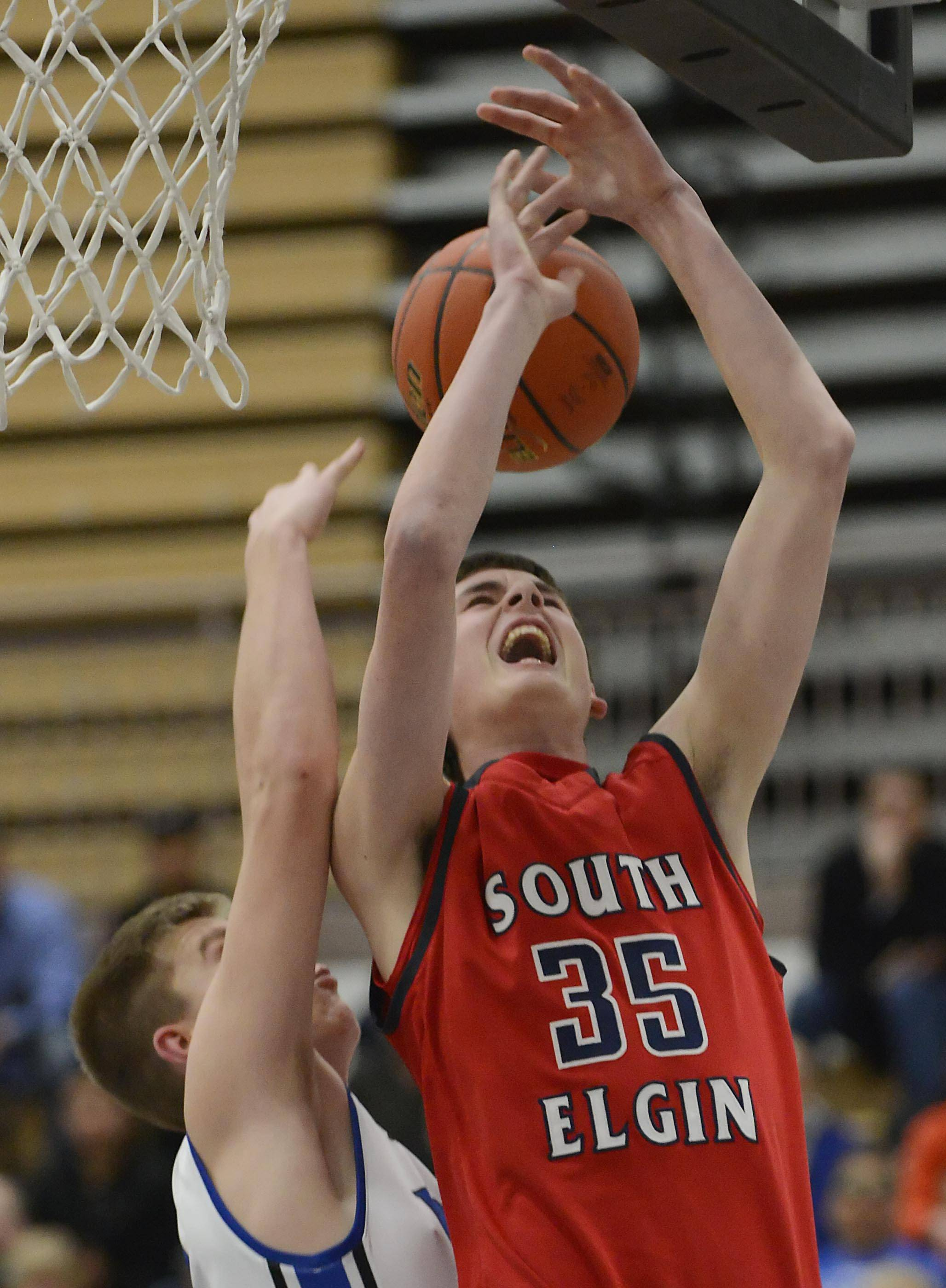 Larkin's Brayden Royse blocks the shot of South Elgin's Tyler Hankins Tuesday in the St. Charles North regional game. See story on Page 6.