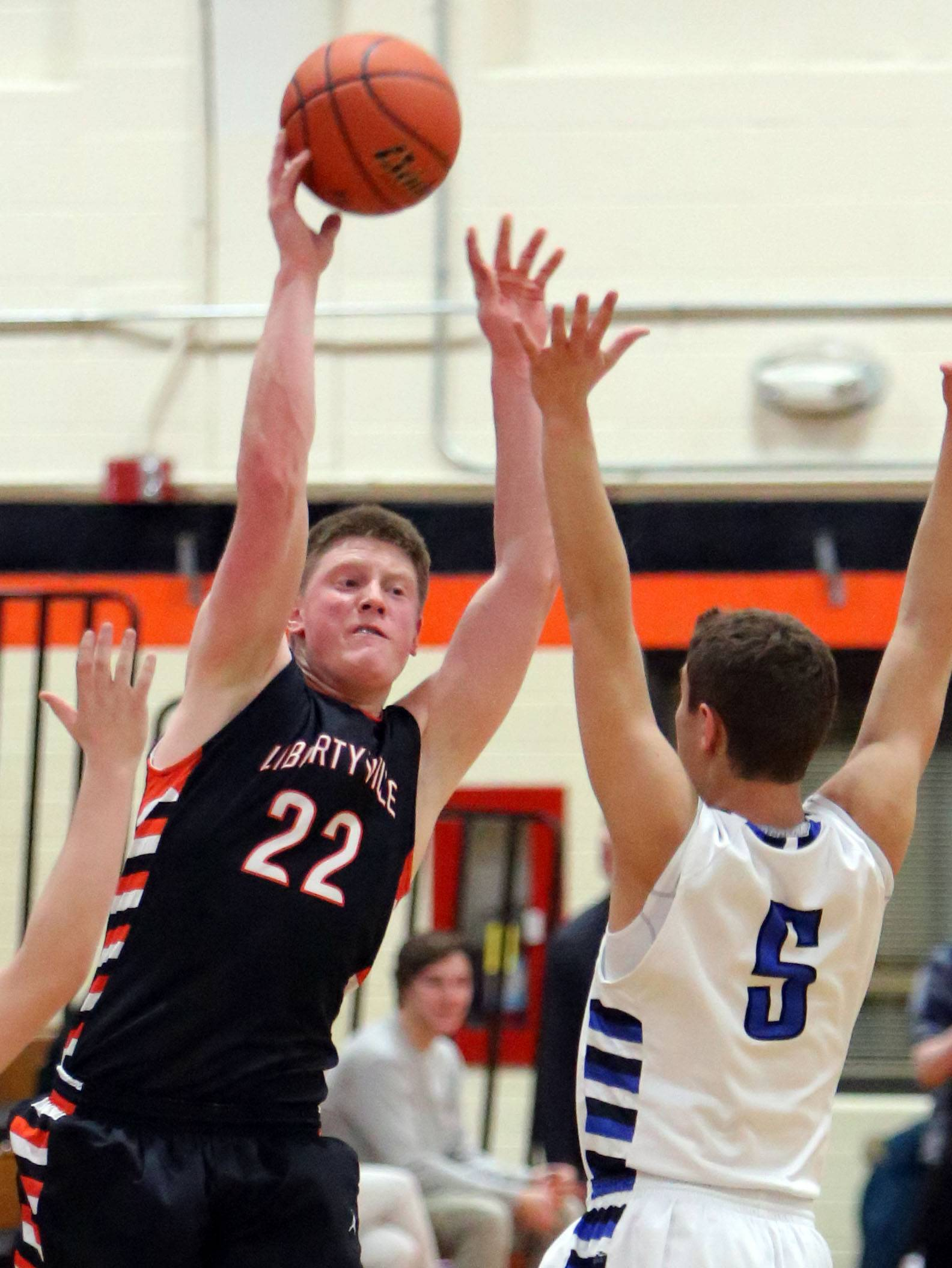 Libertyville's Jack Lipp, left, passes over Highland Park's Max Goshen during Class 4A regional semifinal play at Libertyville on Tuesday.