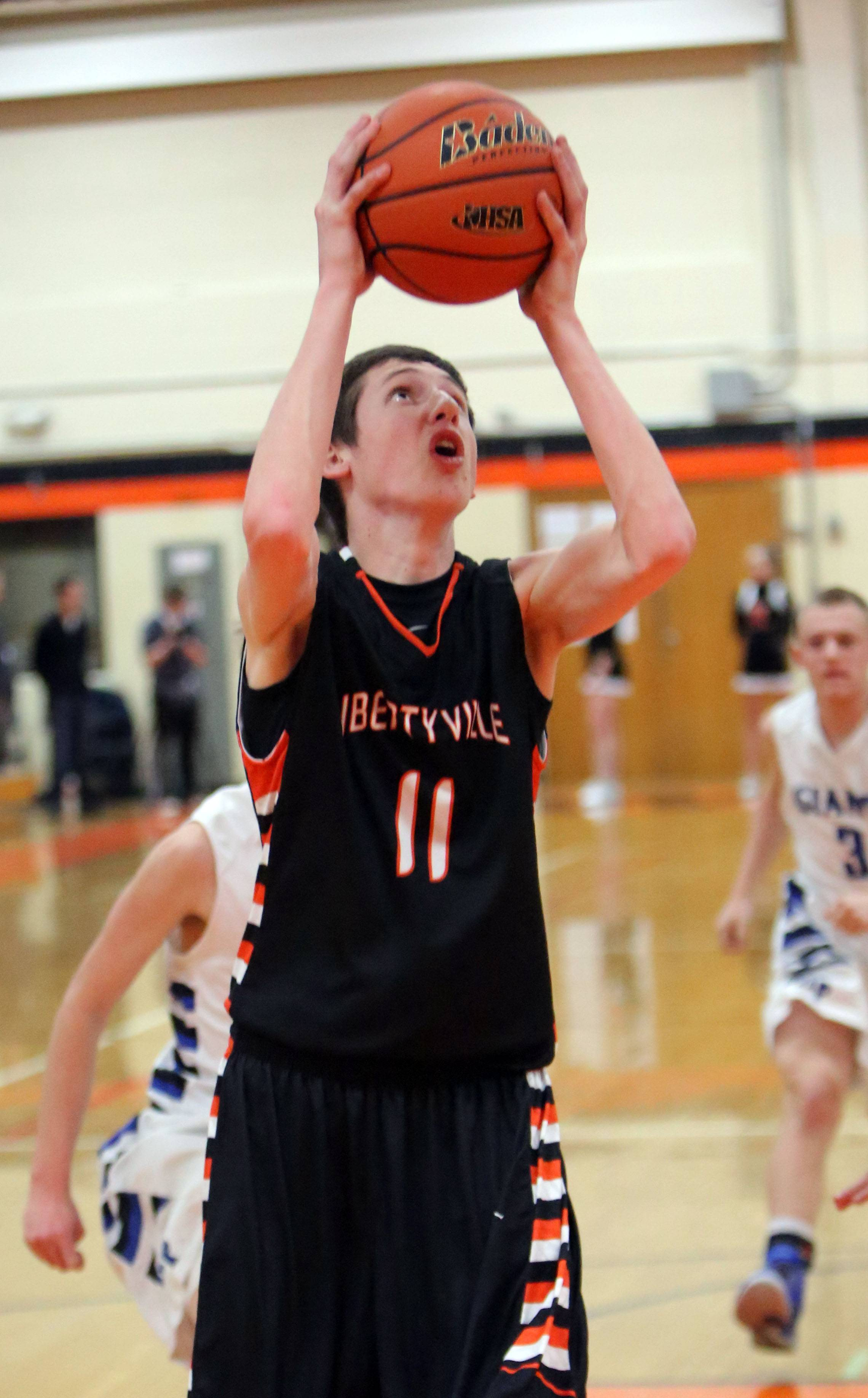 Libertyville's Conor Peterson shoots during Class 4A regional semifinal play at Libertyville on Tuesday.