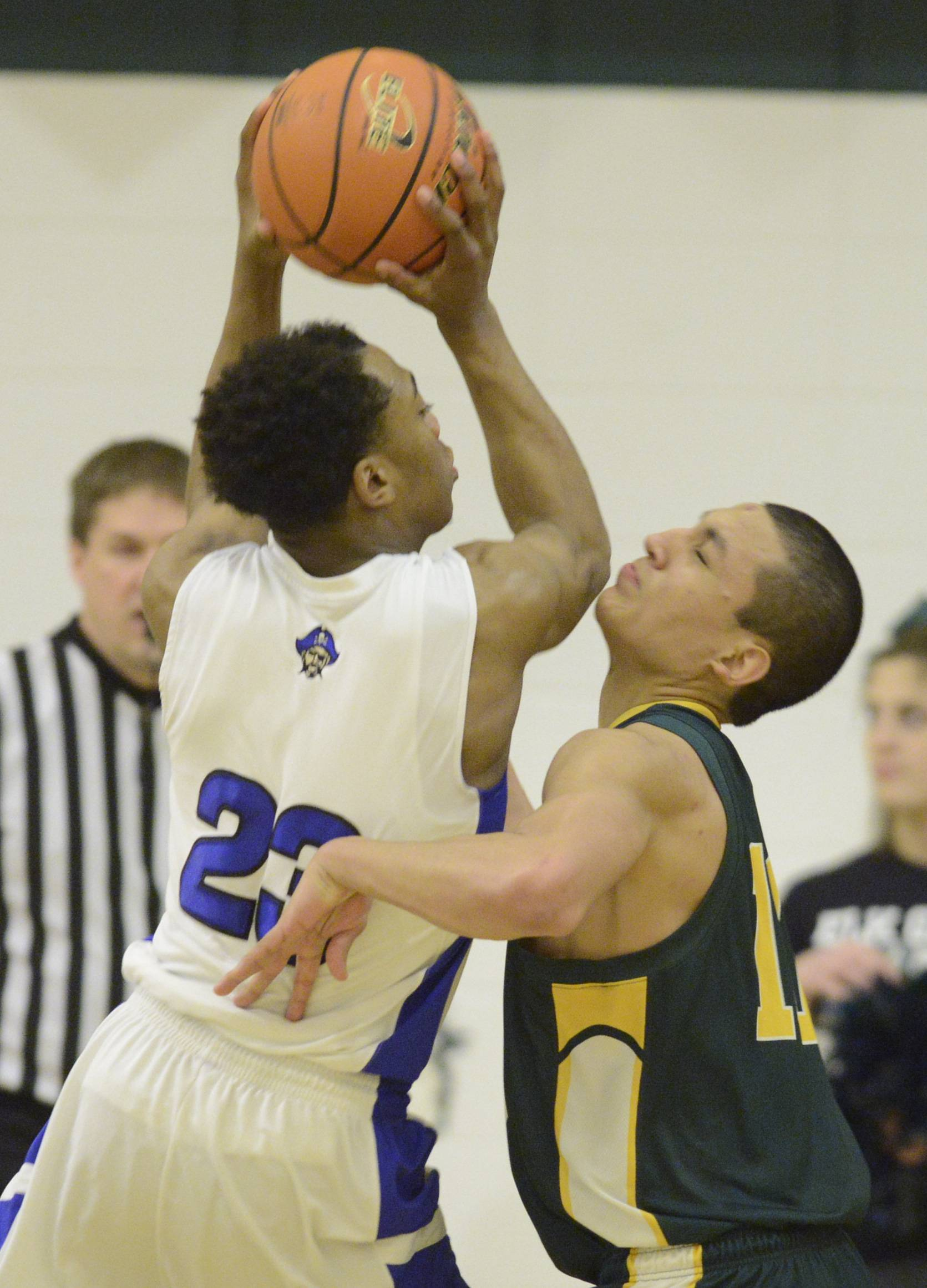 Images from the Elk Grove vs. Proviso East boys regional basketball game  at Elk Grove on Tuesday, March 4, 2014.