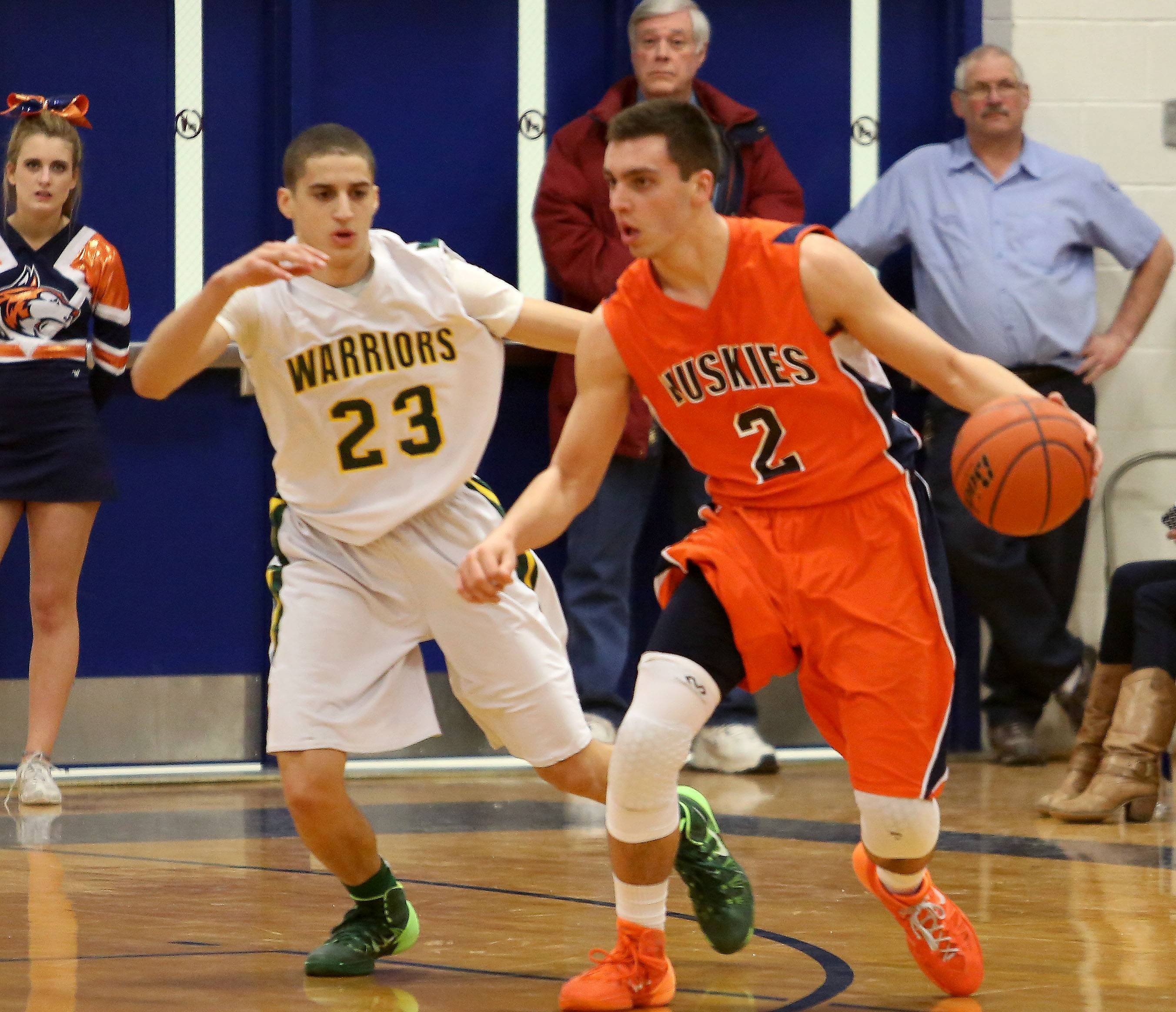 Naperville North's Anthony Rehayem, right, moves around Jay DeHaan, left, of Waubonsie Valley.