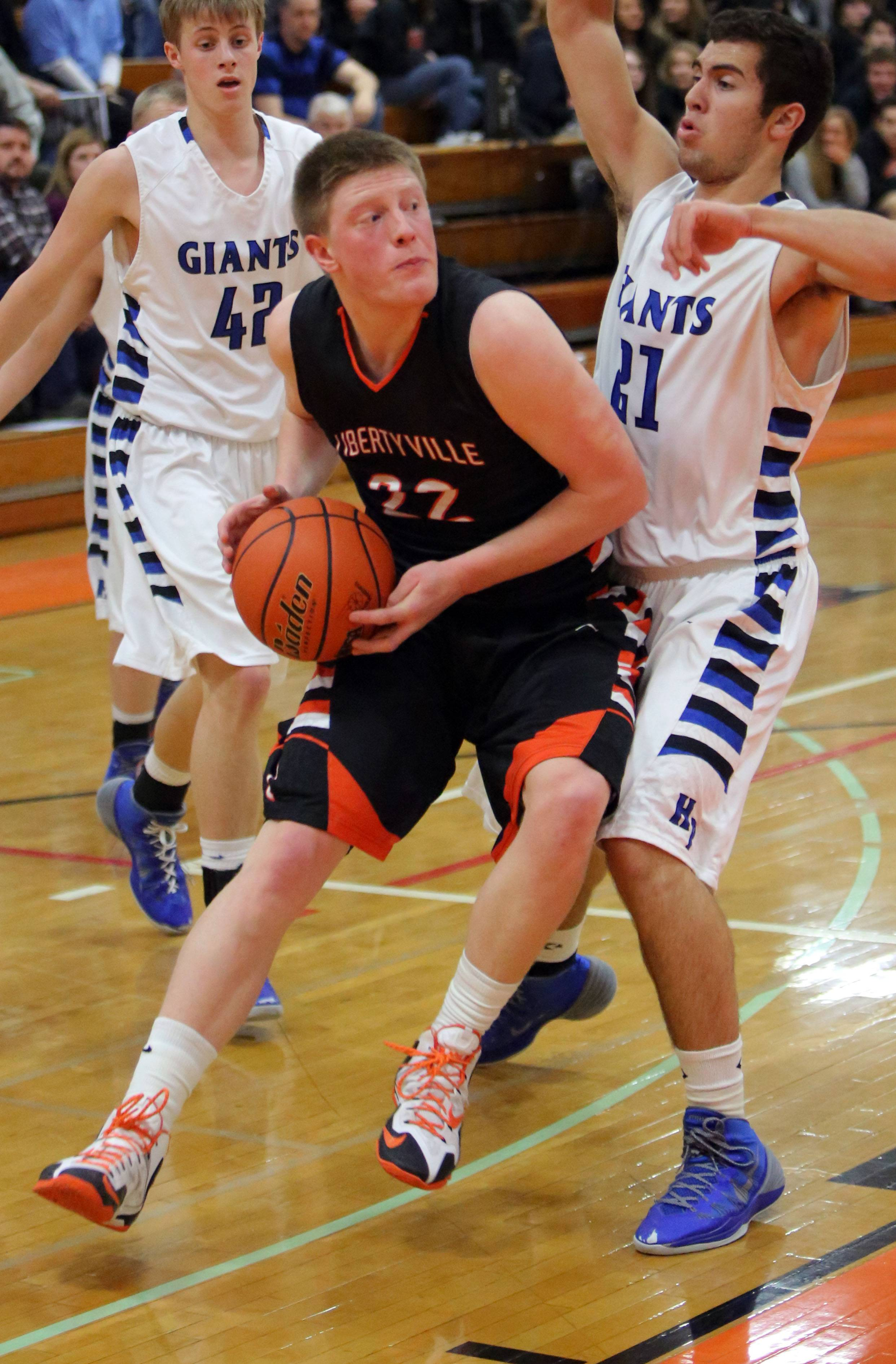 Libertyville's Jack Lipp, left, drives on Highland Park's Tommy Sutker.