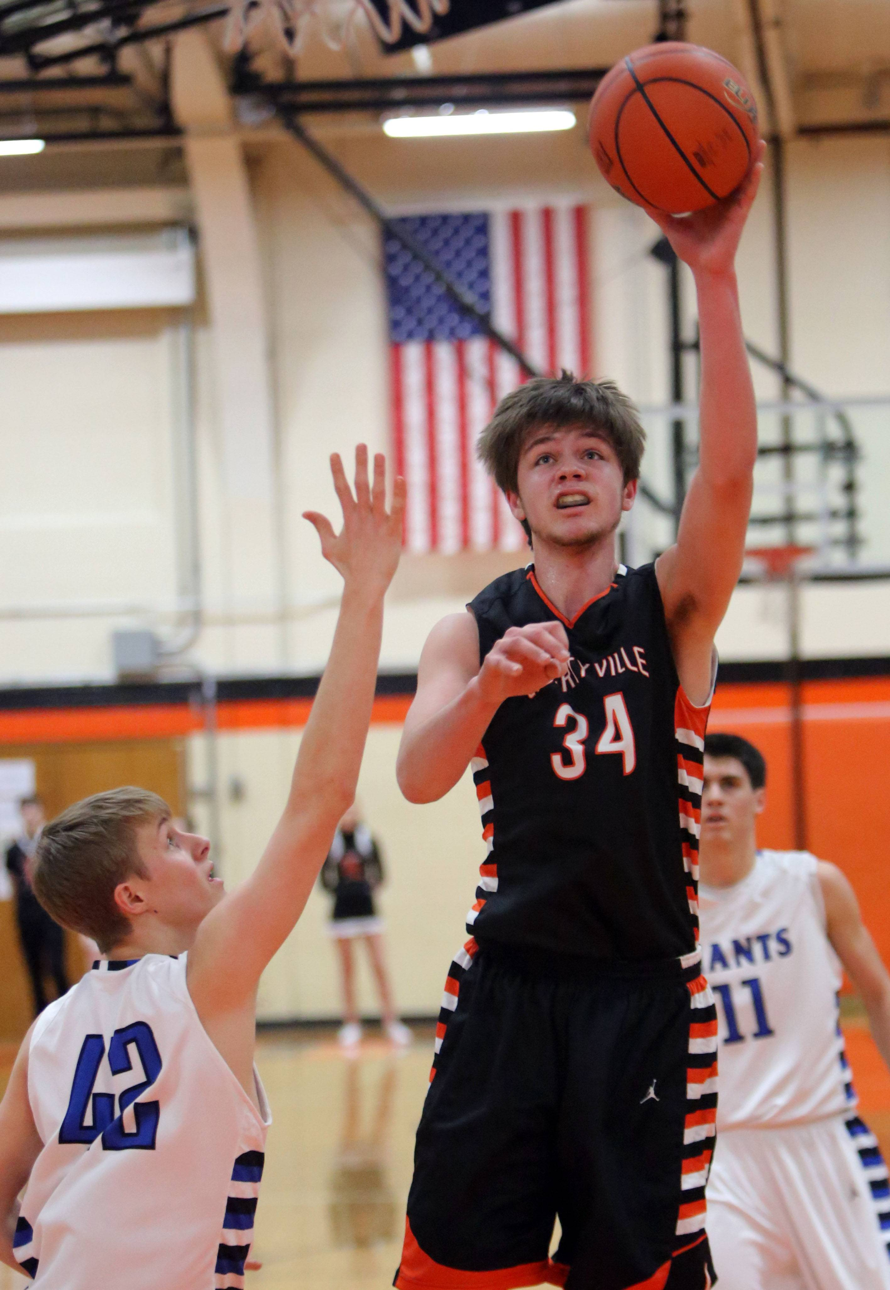 Libertyville's Joe Borcia, right, shoots over Highland Park's Hallvard Lundevall.