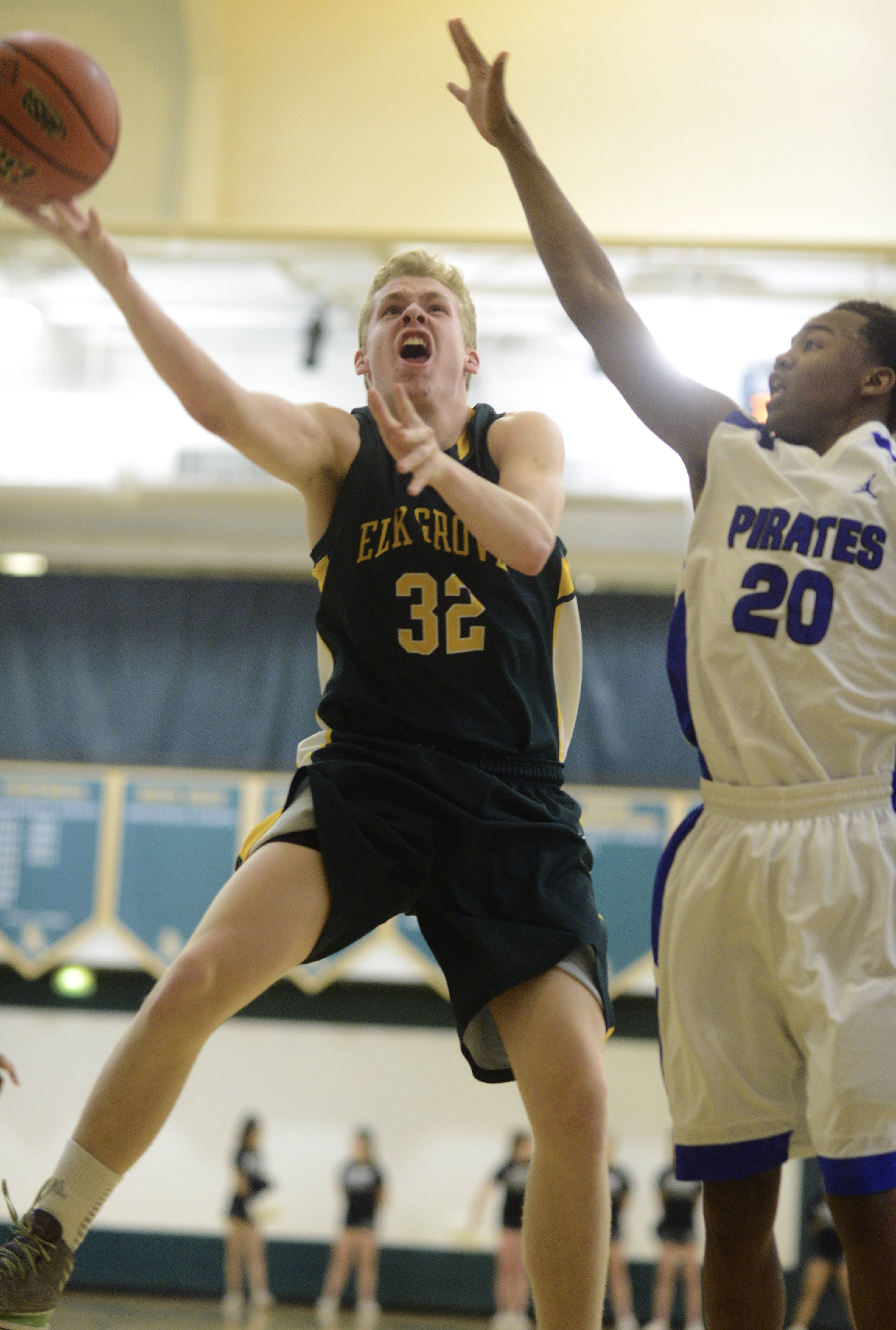 Elk Grove's Scott Furlong, left, drives to the basket against Proviso East's Tyler Chisom during Tuesday's regional semifinal at Elk Grove.