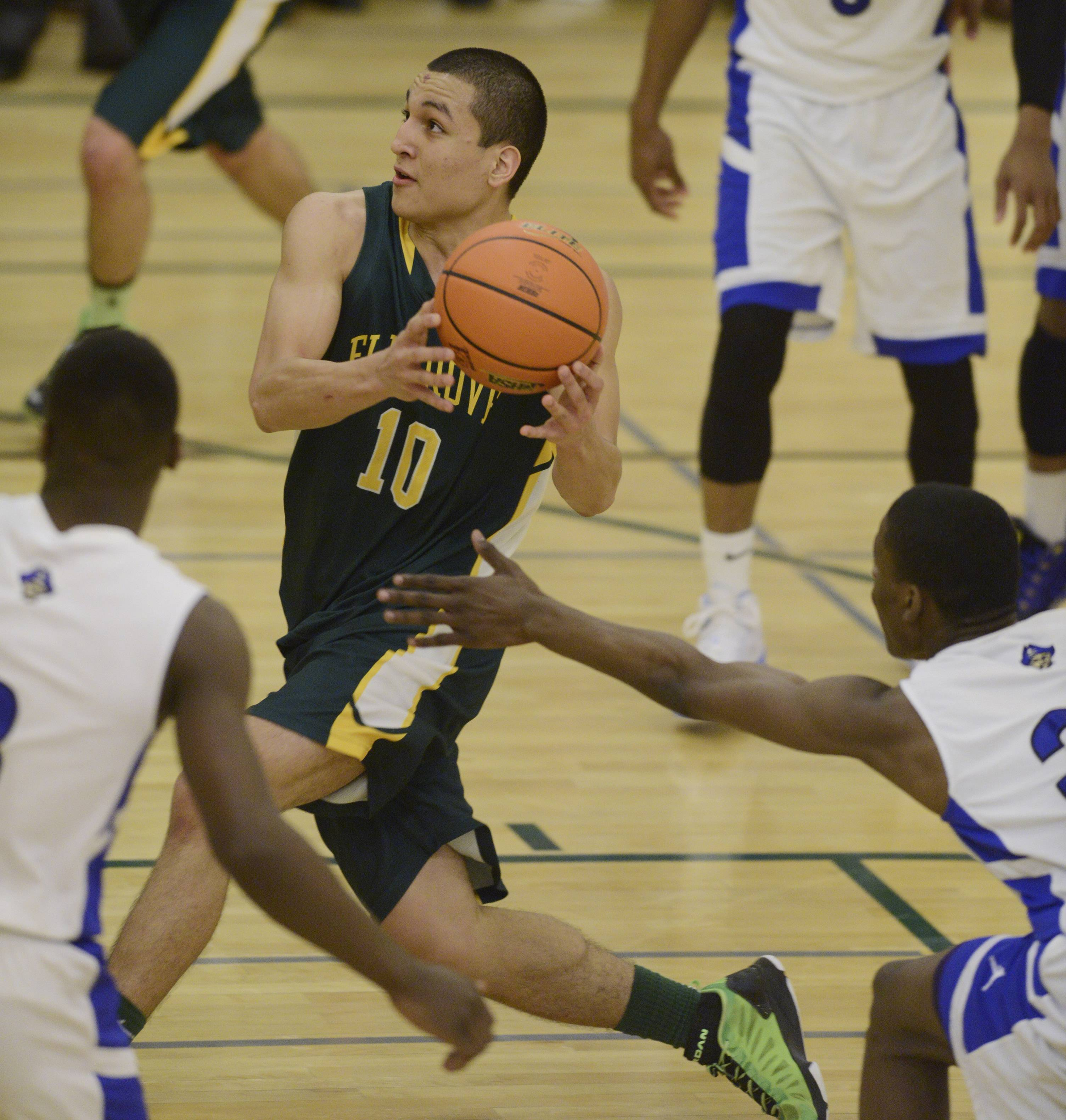 Elk Grove's Joell Melendez drives to the basket during Tuesday's regional semifinal against Proviso East at Elk Grove.