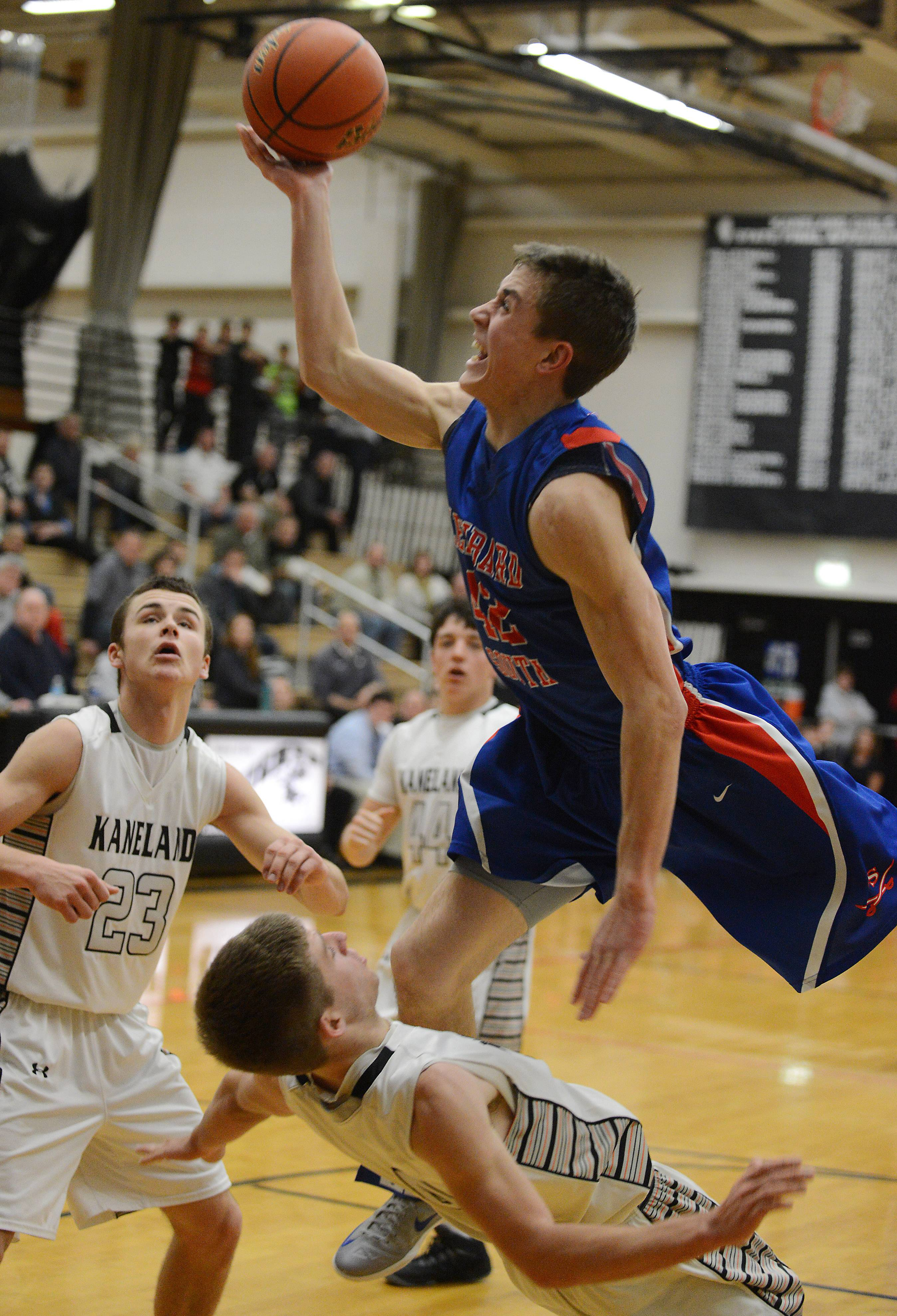 Kaneland's Drew David draws a charge on Glenbard South's Billy Bair.