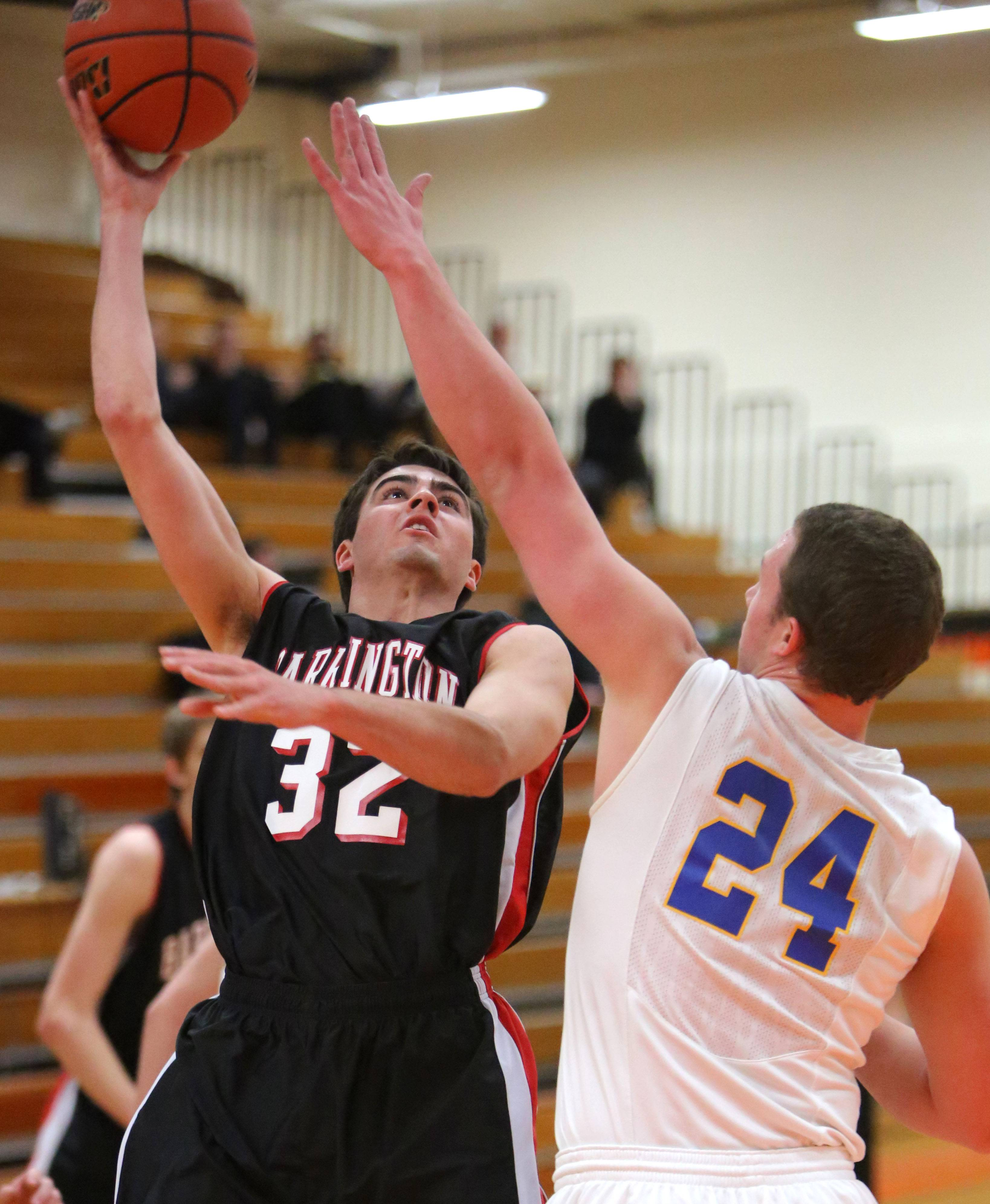 Barrington's Austin Madryzk shoots over Lake Forest's Cal Miller .