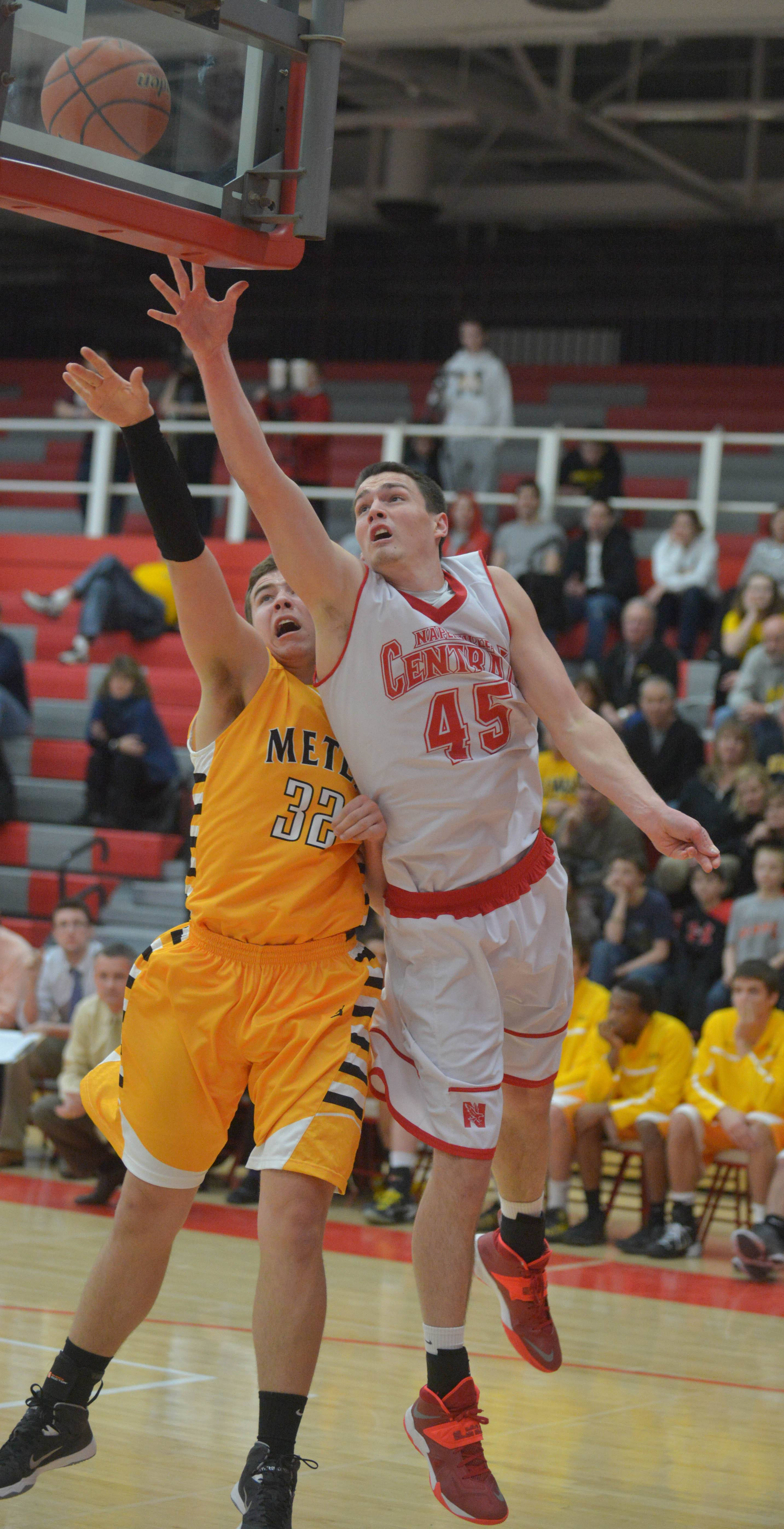 Mark Konkle of Metea Valley and Naperville Central's Nick Czarnowski battle during the Metea Valley vs. Naperville Central Class 4A Naperville Central regional semifinals boys basketball game Wednesday.