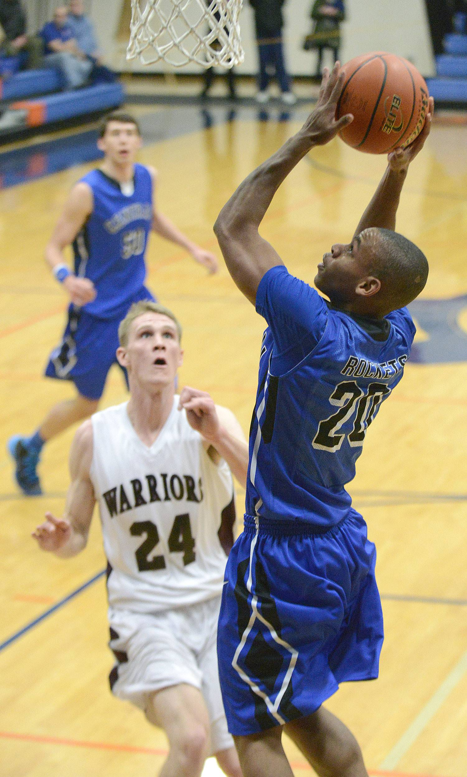 Burlington Central's Reed Hunnicutt shoots over Wheaton Academy's Gordon Behr in the first quarter.