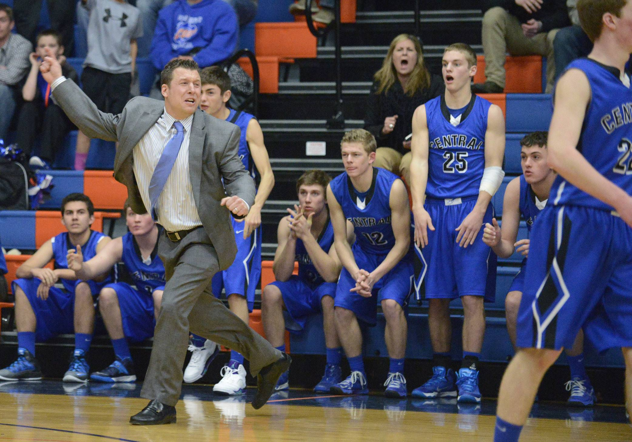 Burlington Central's coach Brett Porto reacts as Wheaton Academy wins.