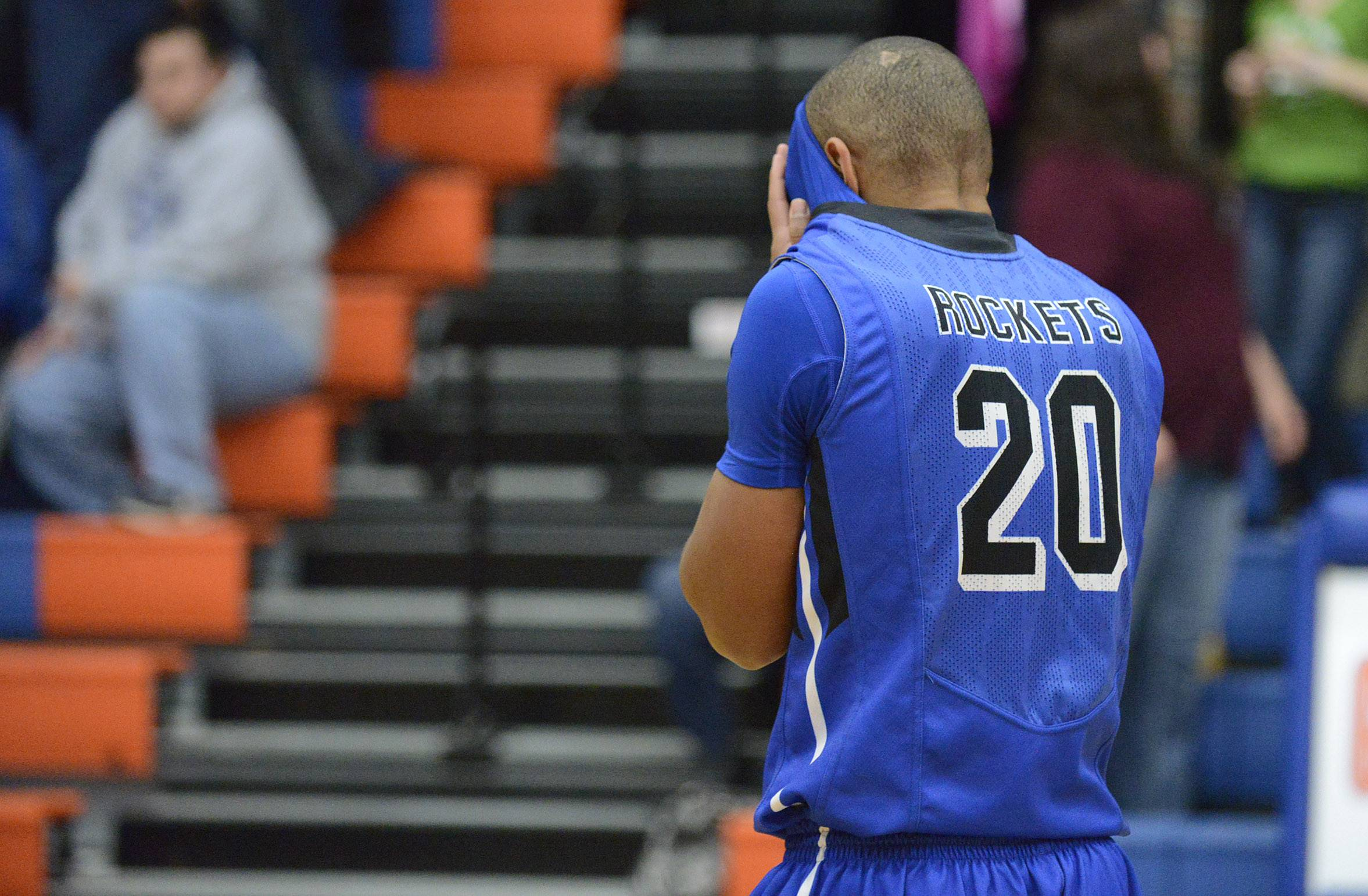 Burlington Central's Reed Hunnicutt walks off the court after the Rockets' loss to Wheaton Academy .