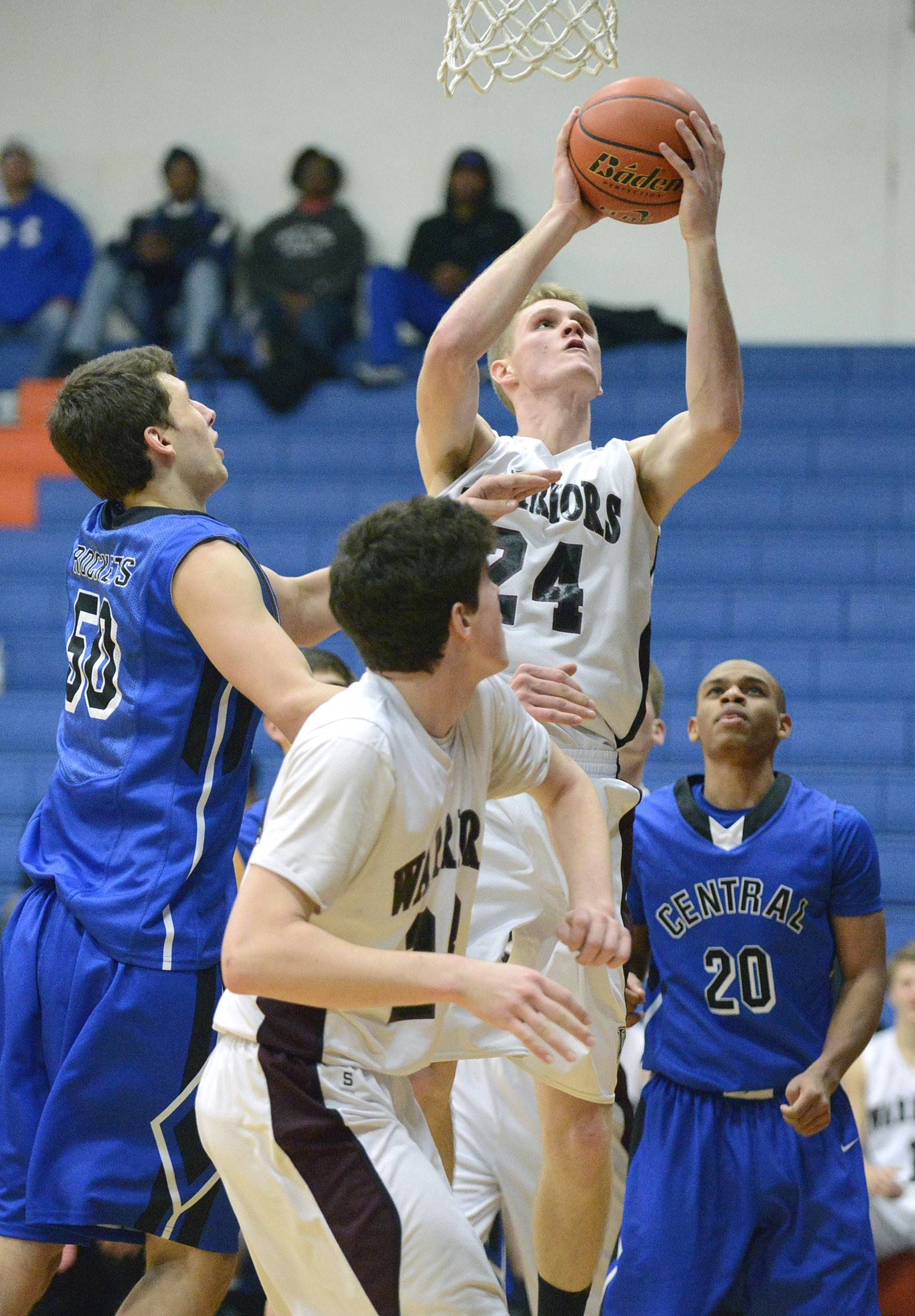 Wheaton Academy's Gordon Behr shoots past Burlington Central's Duncan Ozburn, left, in the fourth quarter.