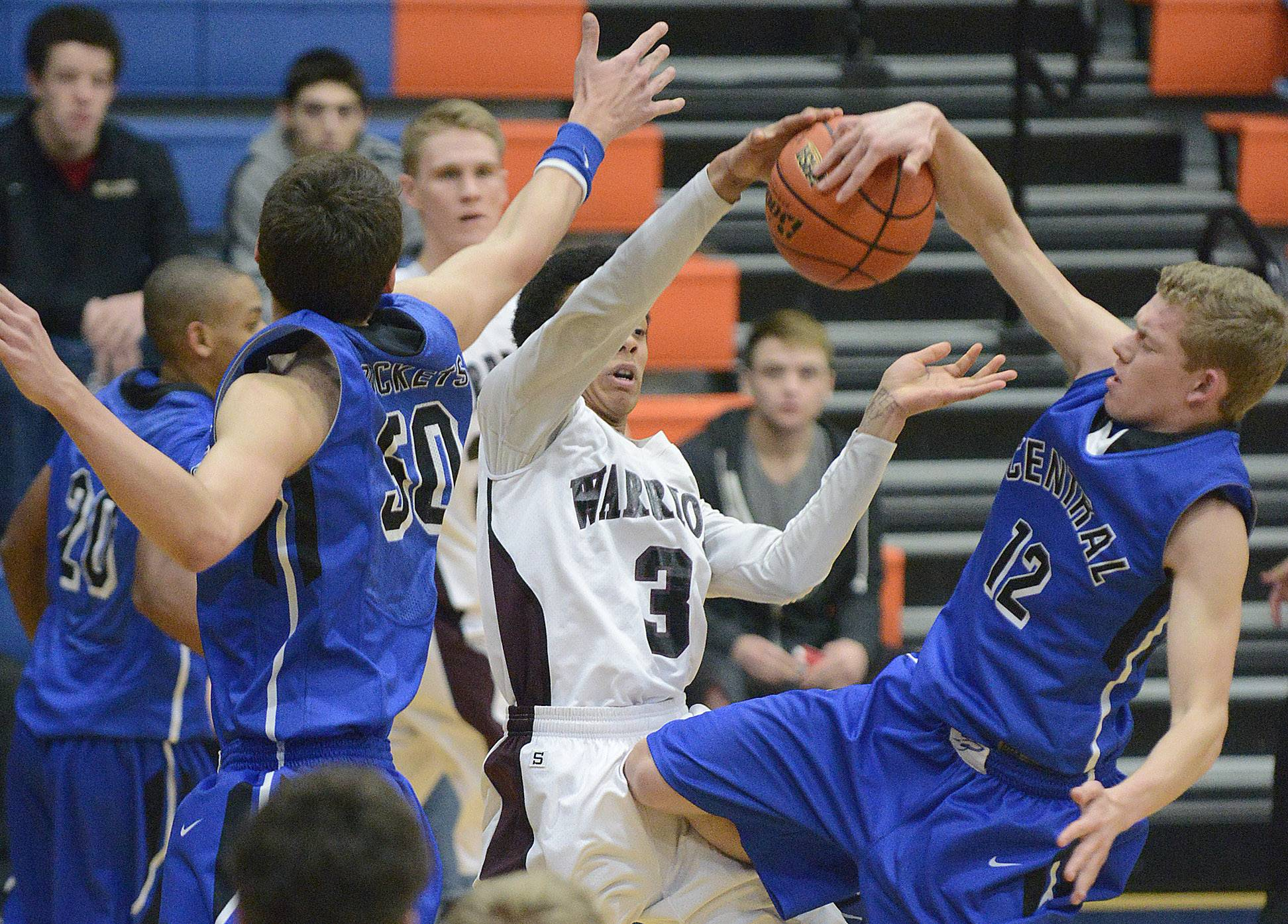 Burlington Central's Stefan Jochum denies Wheaton Academy's Christian Smith a shot in the third quarter.