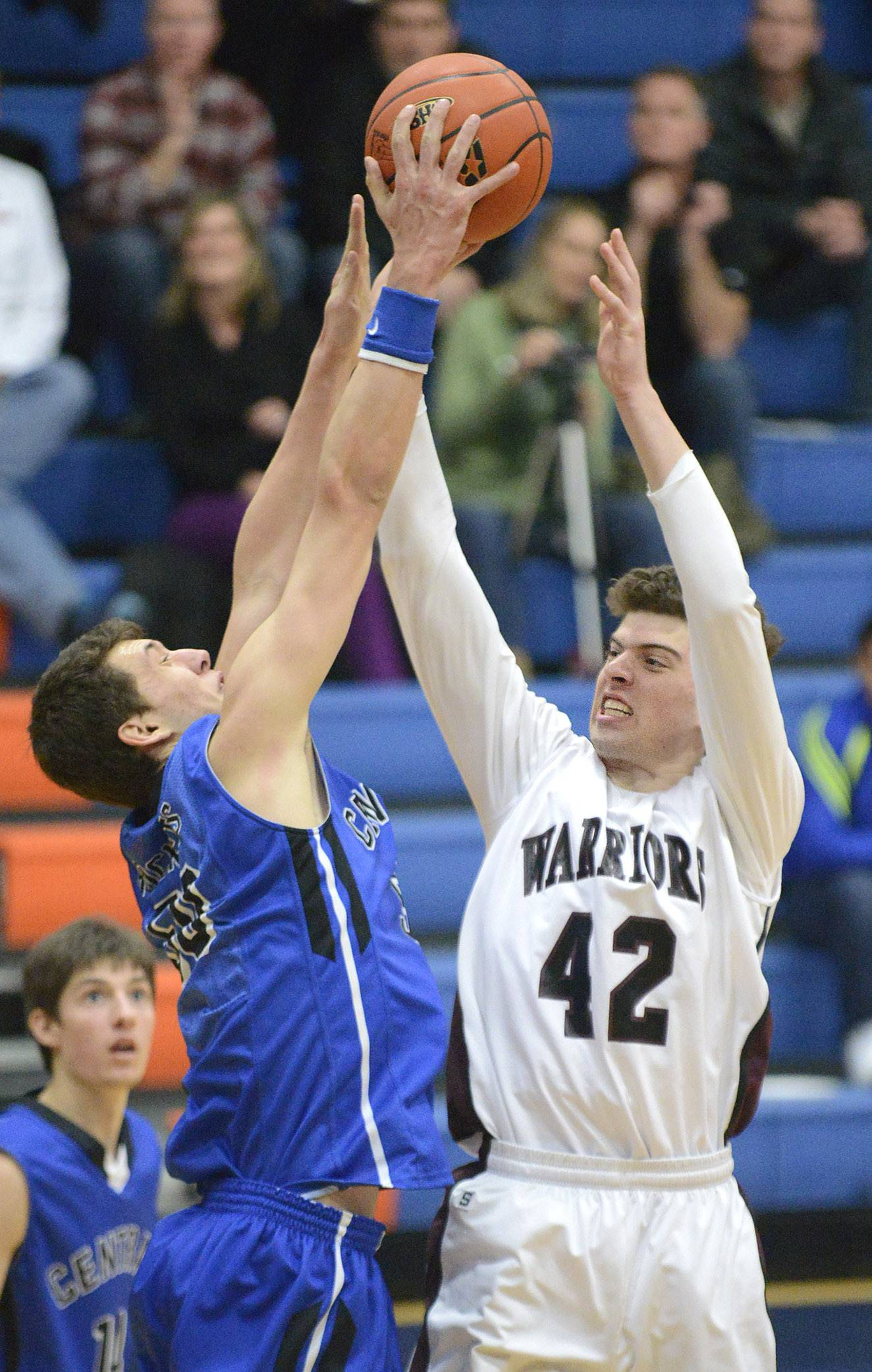 Burlington Central's Duncan Ozburn blocks a shot by Wheaton Academy's Chandler Fuzak in the third quarter .