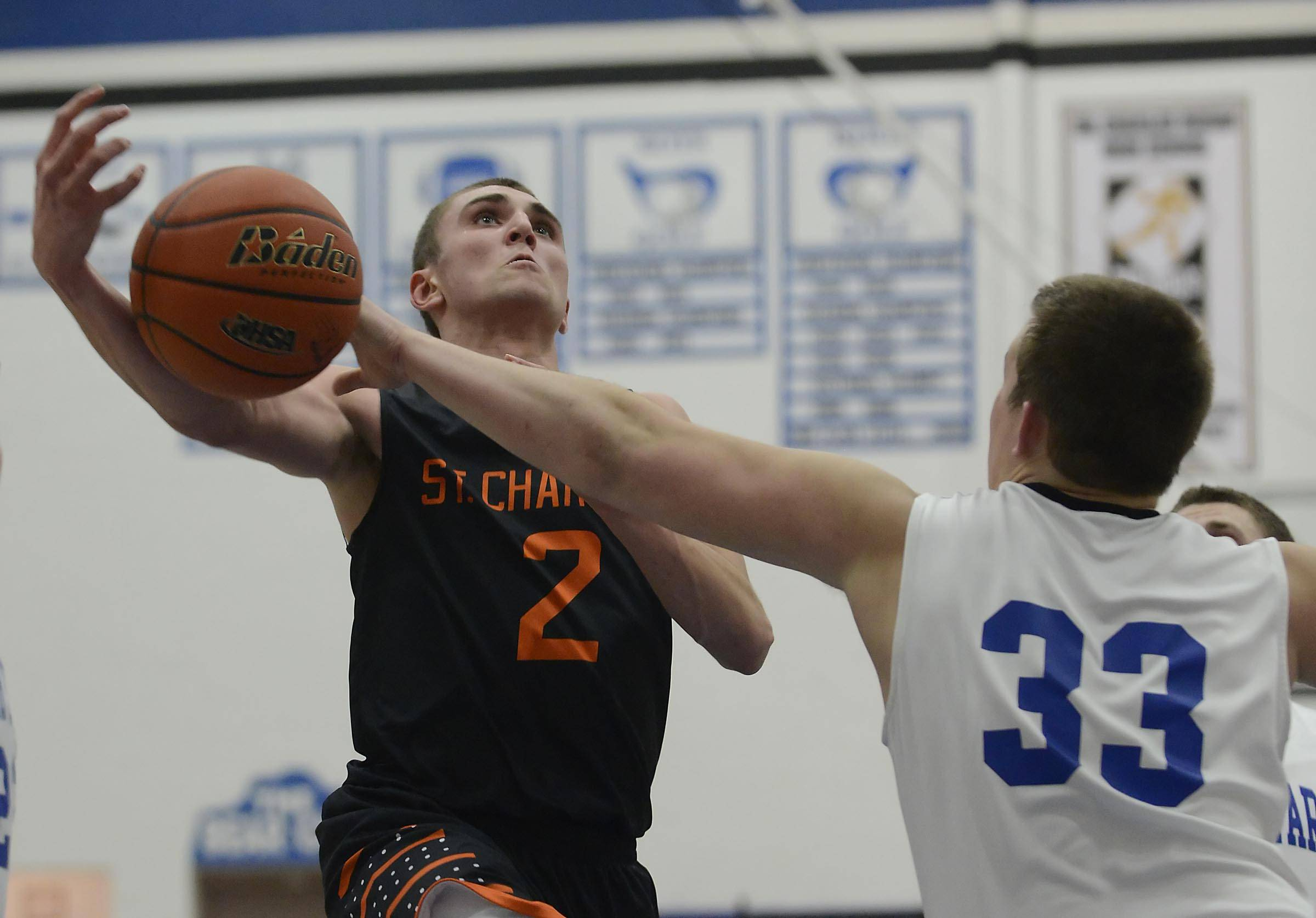 St. Charles North's Camden Cotter knocks the ball from St. Charles East's Dom Adduci Wednesday in the regional game at St. Charles North.