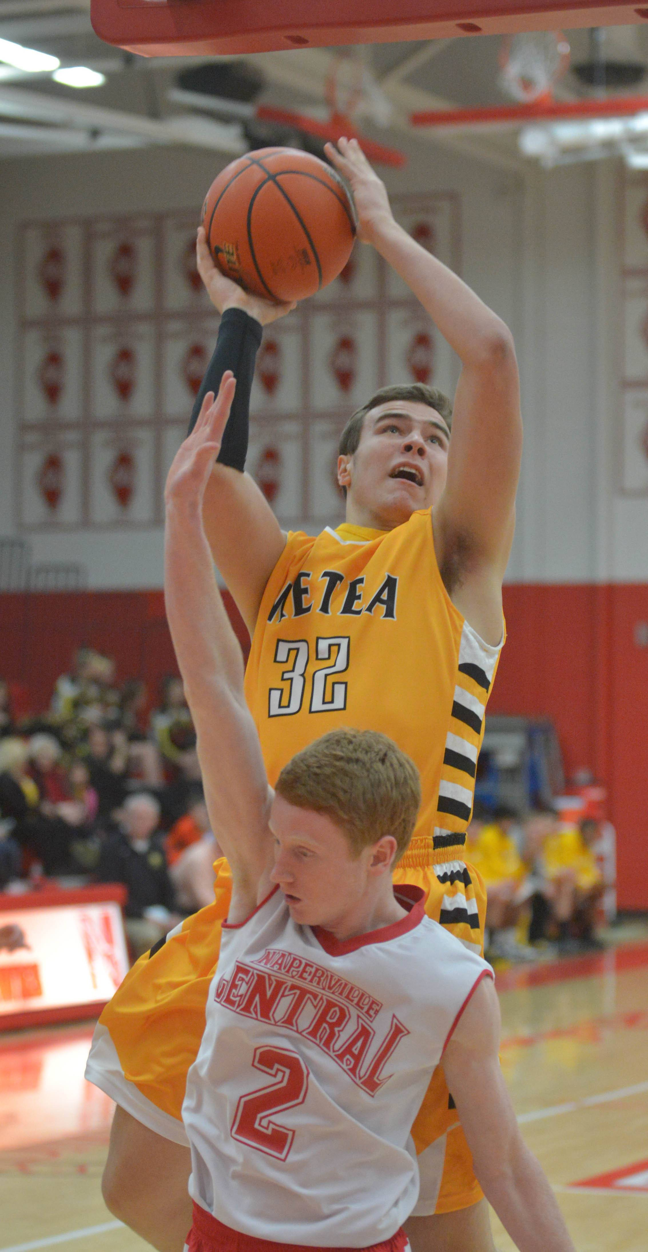 Mark Konkle of Metea Valleytakes a shot over Matt Bennett of  Naperville Central  .