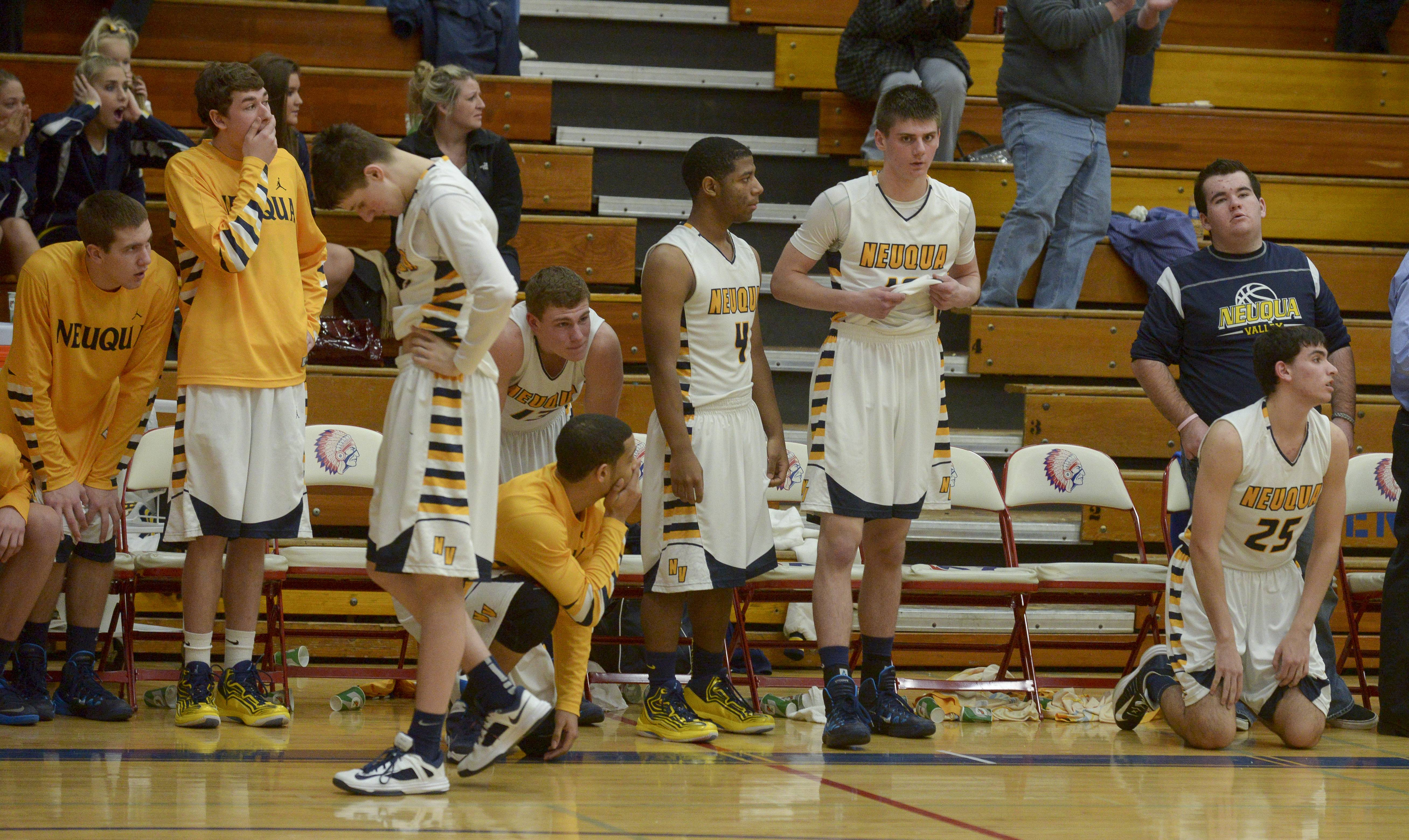 Players on the Neuqua Valley bench react after the game.