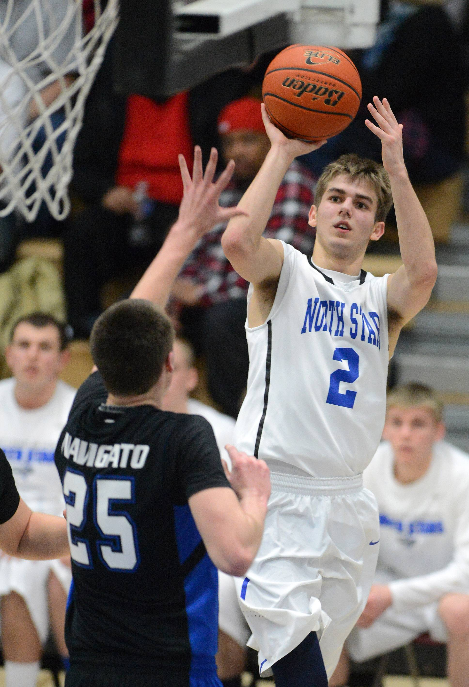 Rick West/rwest@dailyherald.comSt. Charles North's Jake Ludwig (2) shoots and scores over Geneva's Nate Navigato (25) during Friday's game in St. Charles.