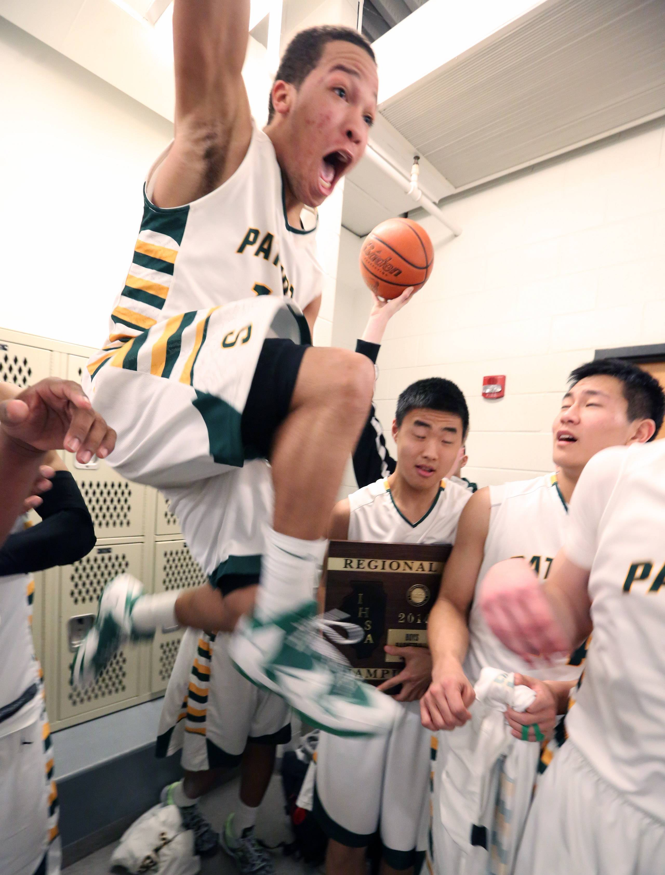 Stevenson guard Jalen Brunson leads a locker-room celebration after the Patriots topped Warren 79-59 in Class 4A regional final play at McHenry on Friday.