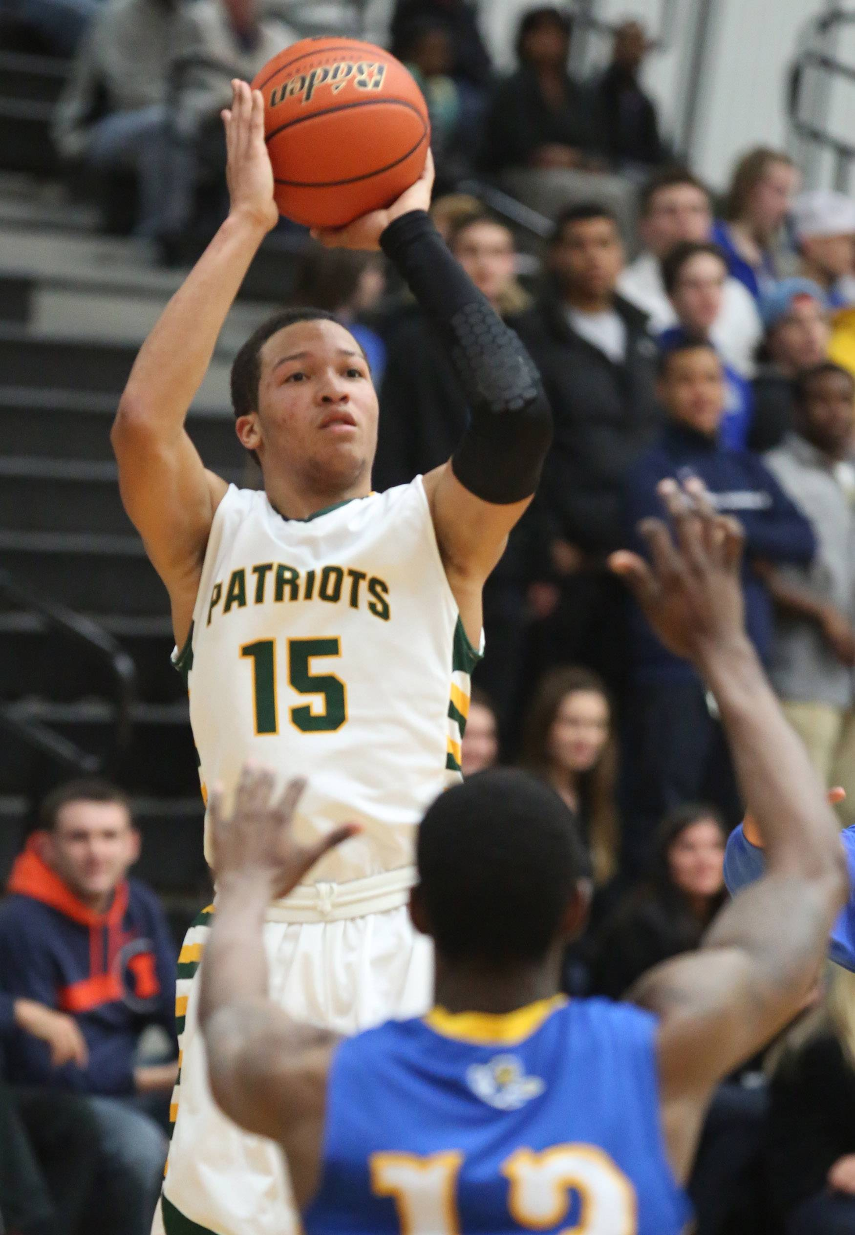 Stevenson guard Jalen Brunson measures a 3-pointer in the Patriots' 79-59 victory over Warren in Class 4A regional play Friday at McHenry.