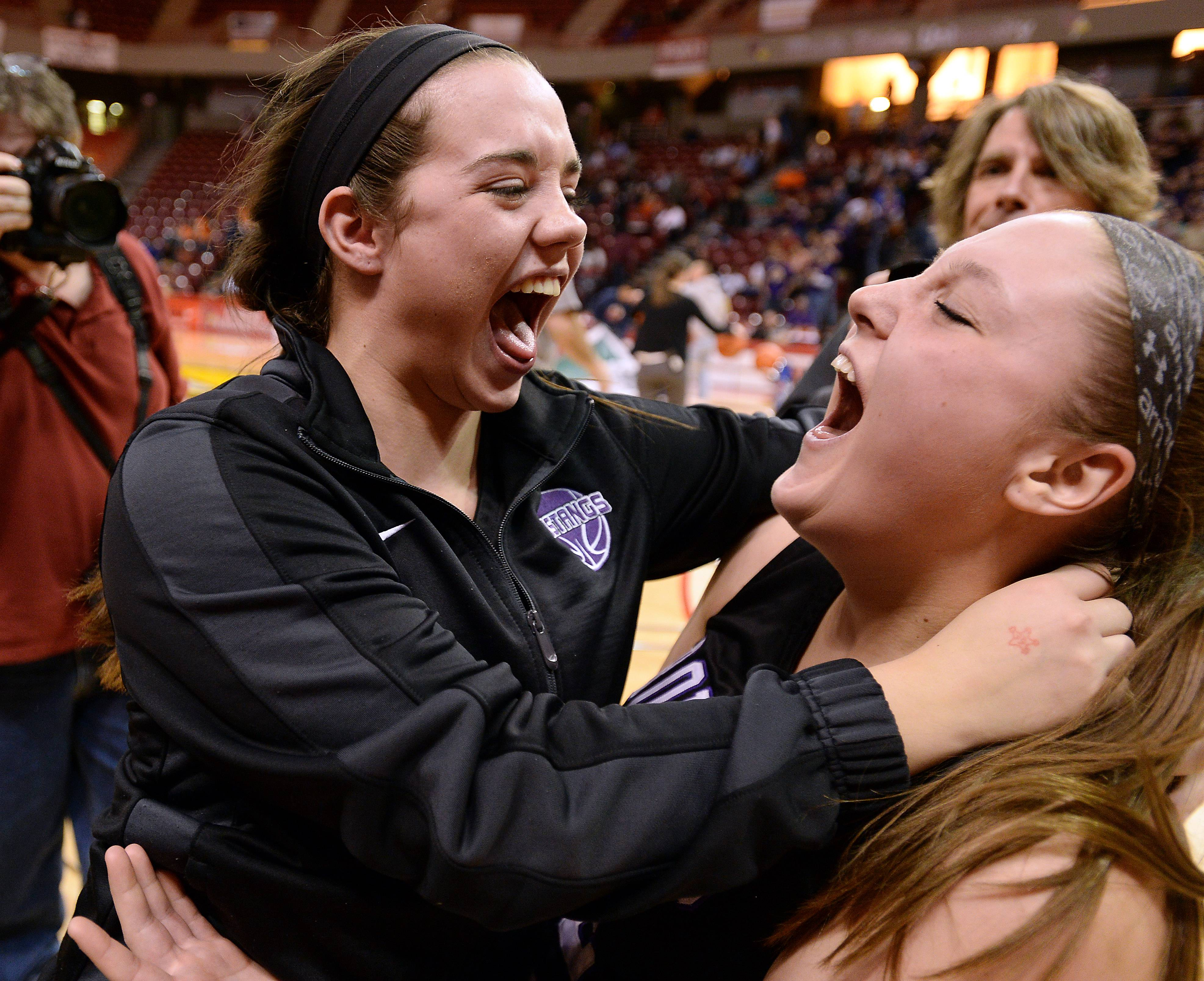 Mark Welsh/mwelsh@dailyherald.comRolling Meadows' Jamie Berry celebrates with Katie Shewmon after the Mustangs topped Geneva in the Class 4A state semifinals in Normal on Friday.
