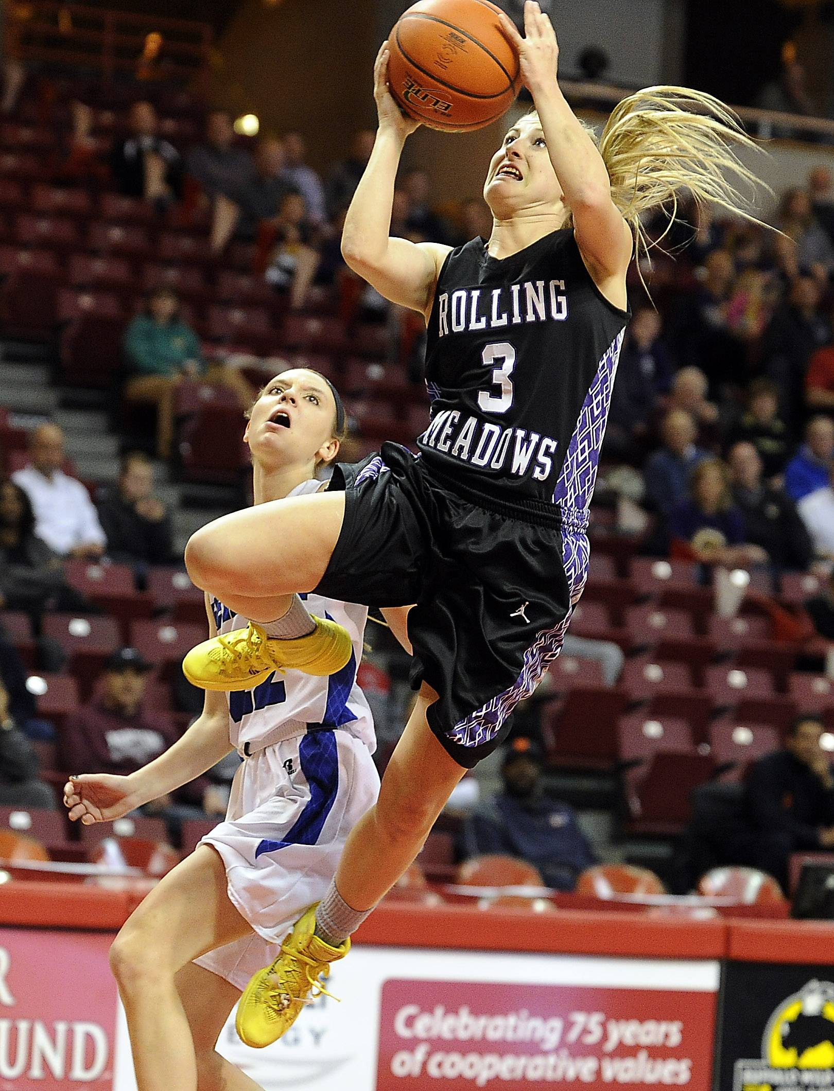 Rolling Meadows' Jackie Kemph gets to the basket after a steal from Geneva's Sidney Santos in the first half of the Class 4A state semifinals in Normal on Friday.