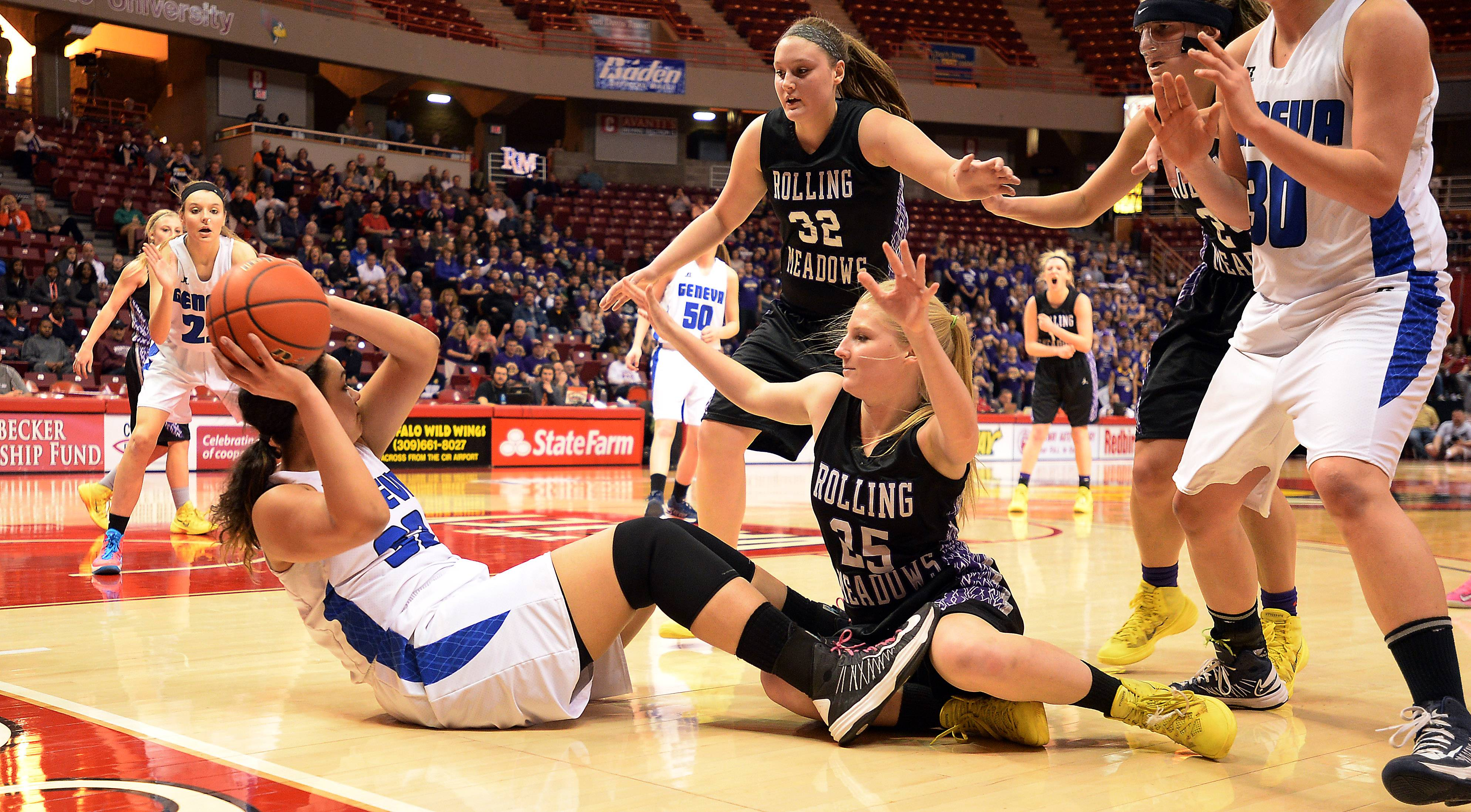 Rolling Meadows Allie Kemph tries to block Geneva's Sidney Santos from passing to her teammates in the first half of the Class 4A state semifinals in Normal on Friday.