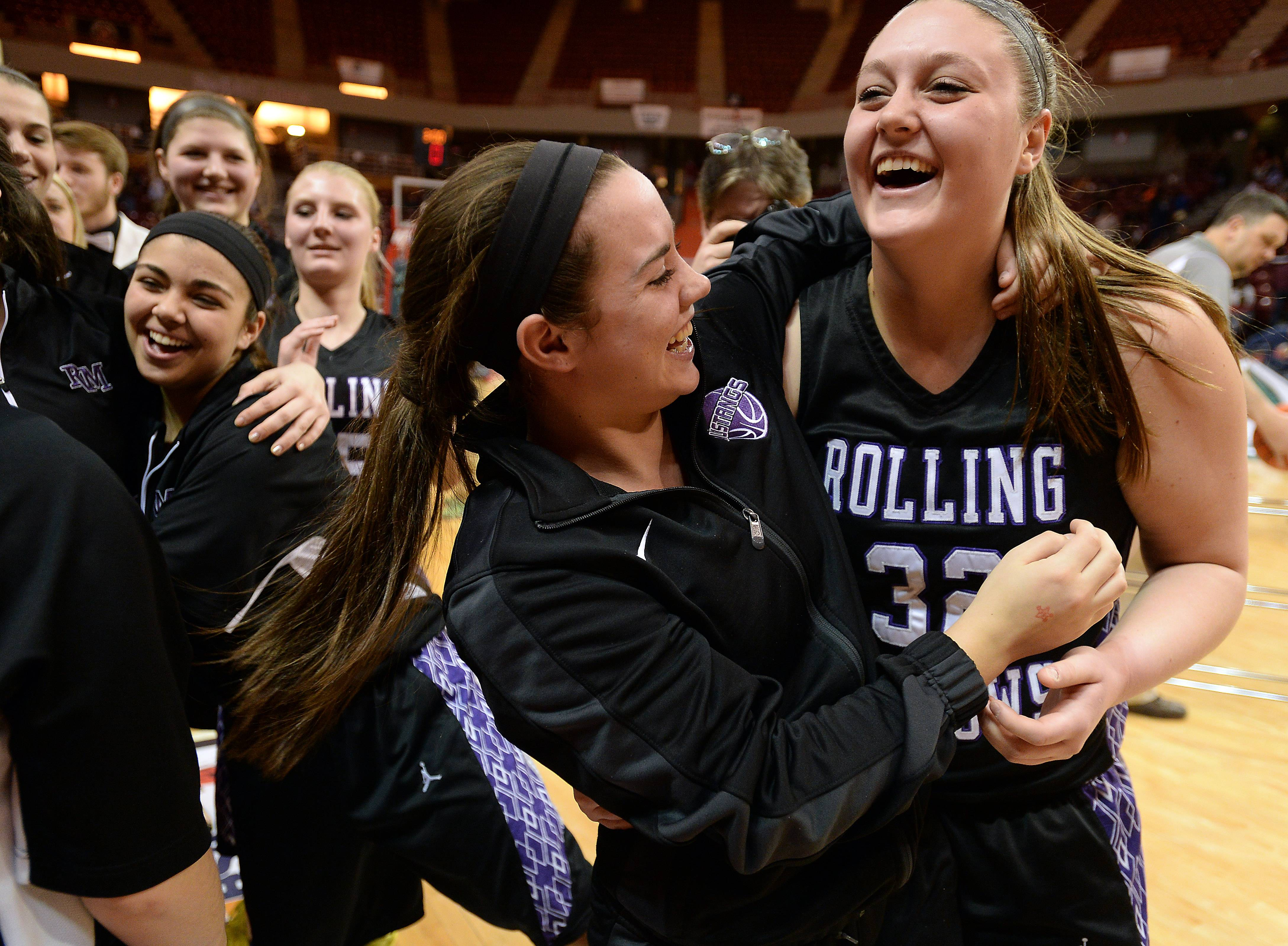 Rolling Meadows' Jamie Berry celebrates with Katie Shewmon after the Mustangs topped Geneva in the Class 4A state semifinals in Normal on Friday.
