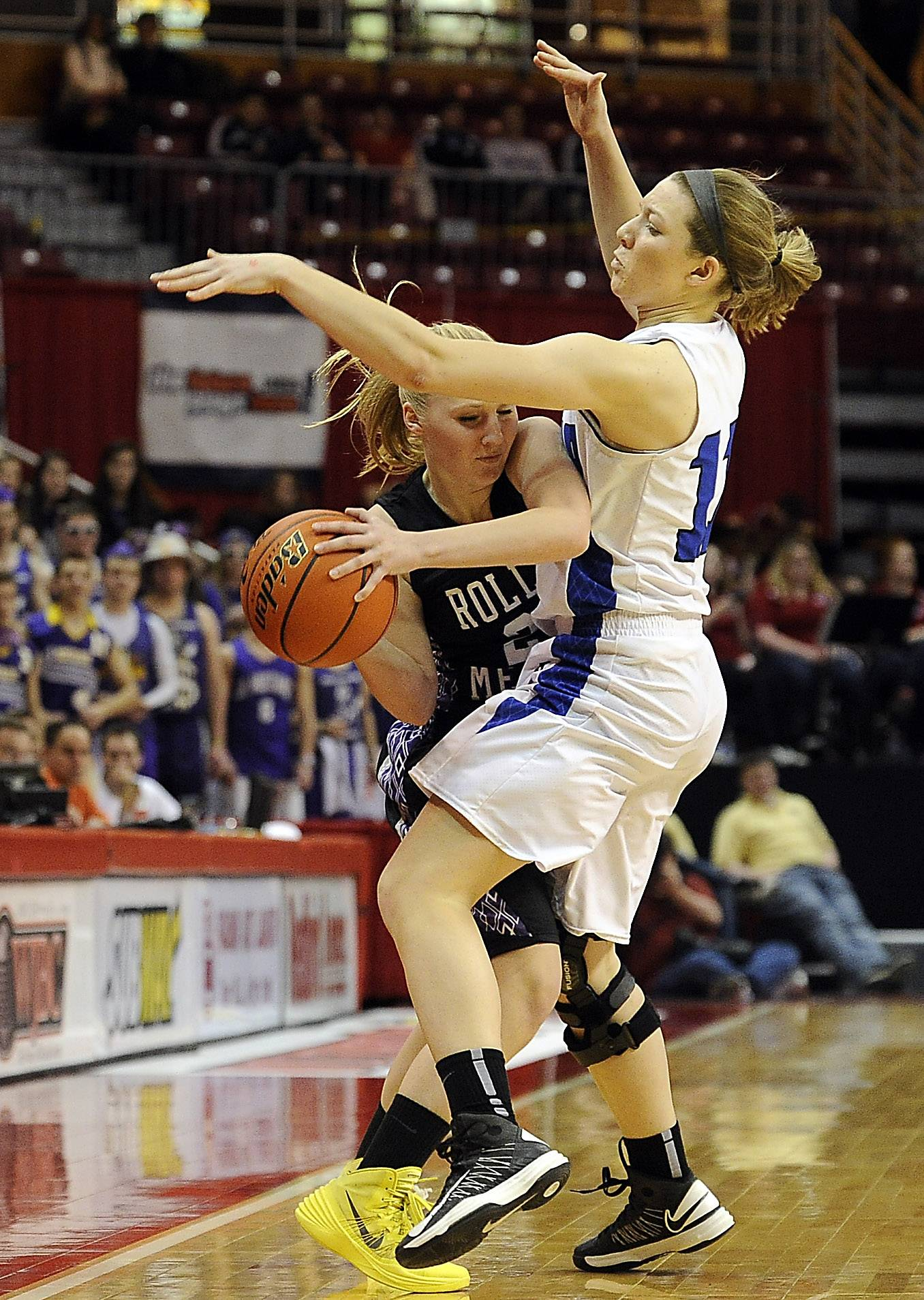 Geneva's Michaela Loebel fouls Rolling Meadows' Allie Kemph in the second half of the Class 4A state semifinals in Normal on Friday.