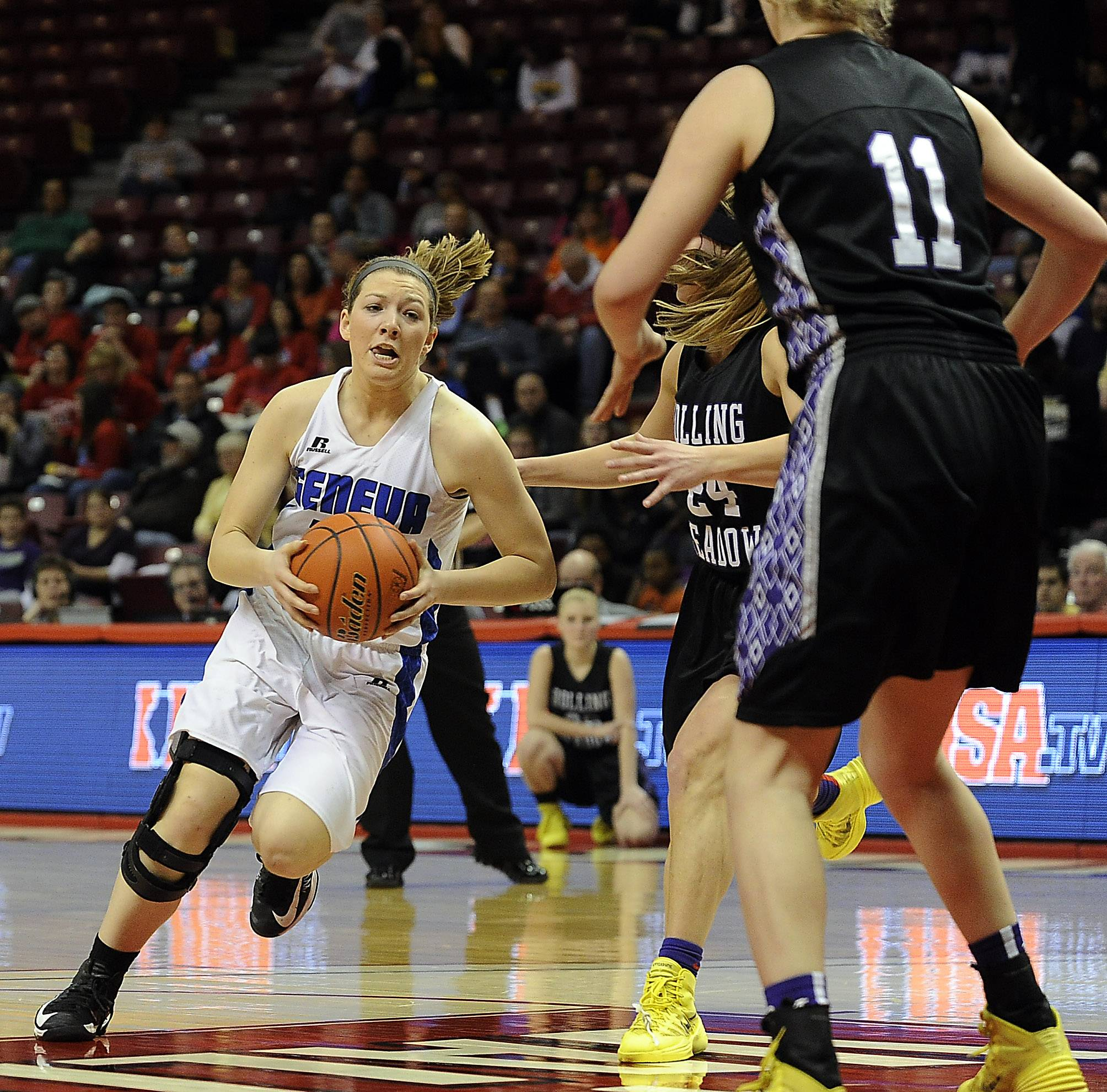 Geneva's Michaela Loebel powers way through Rolling Meadows defenders Alexis Glasgow and Jenny Vliet in the second half of the Class 4A state semifinals in Normal on Friday.