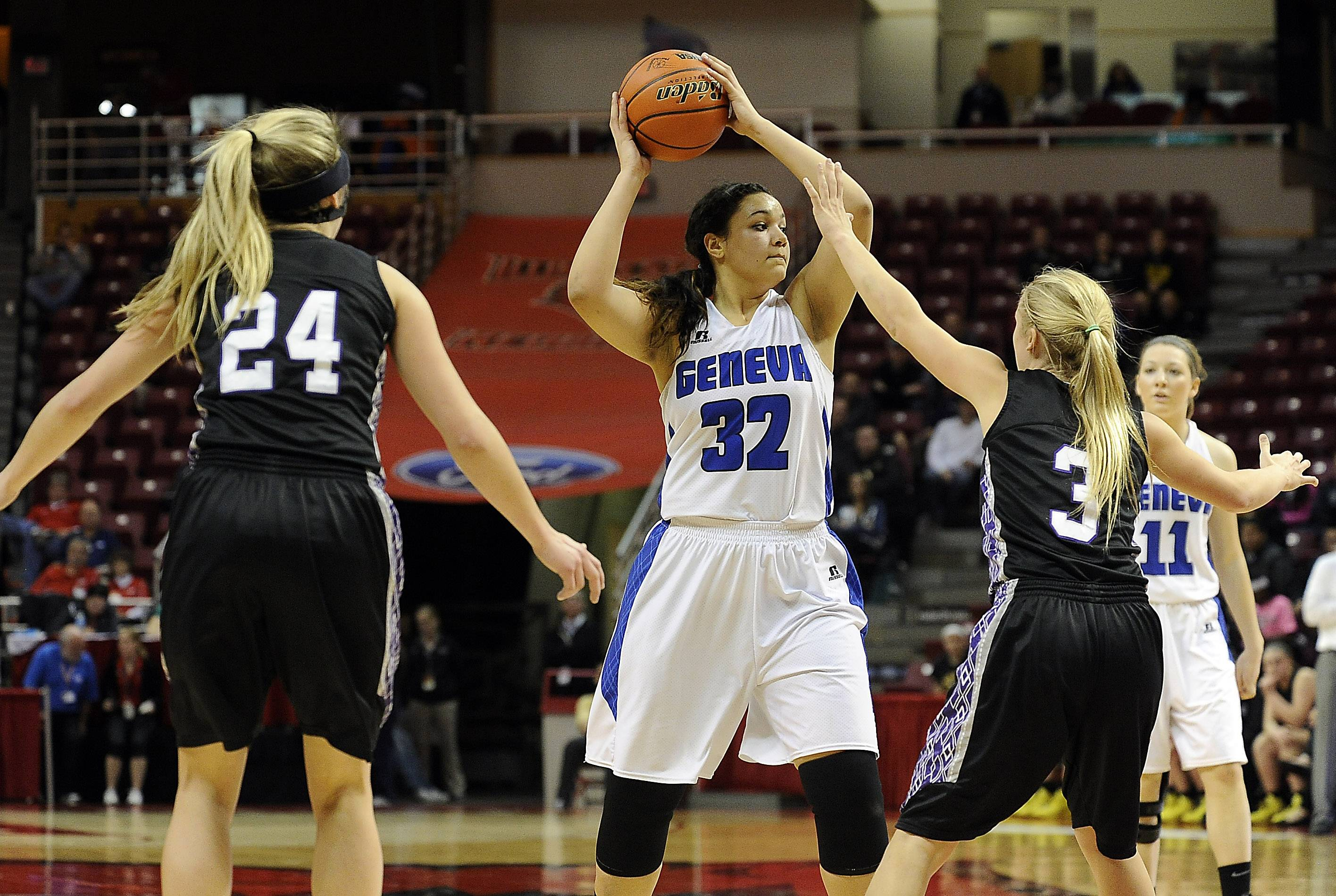 Geneva's Sidney Santos goes up against Rolling Meadows' Alexis Glasgow and Jackie Kemph in the second half of the Class 4A state semifinals in Normal on Friday. Santos fouled out in the fourth quarter.