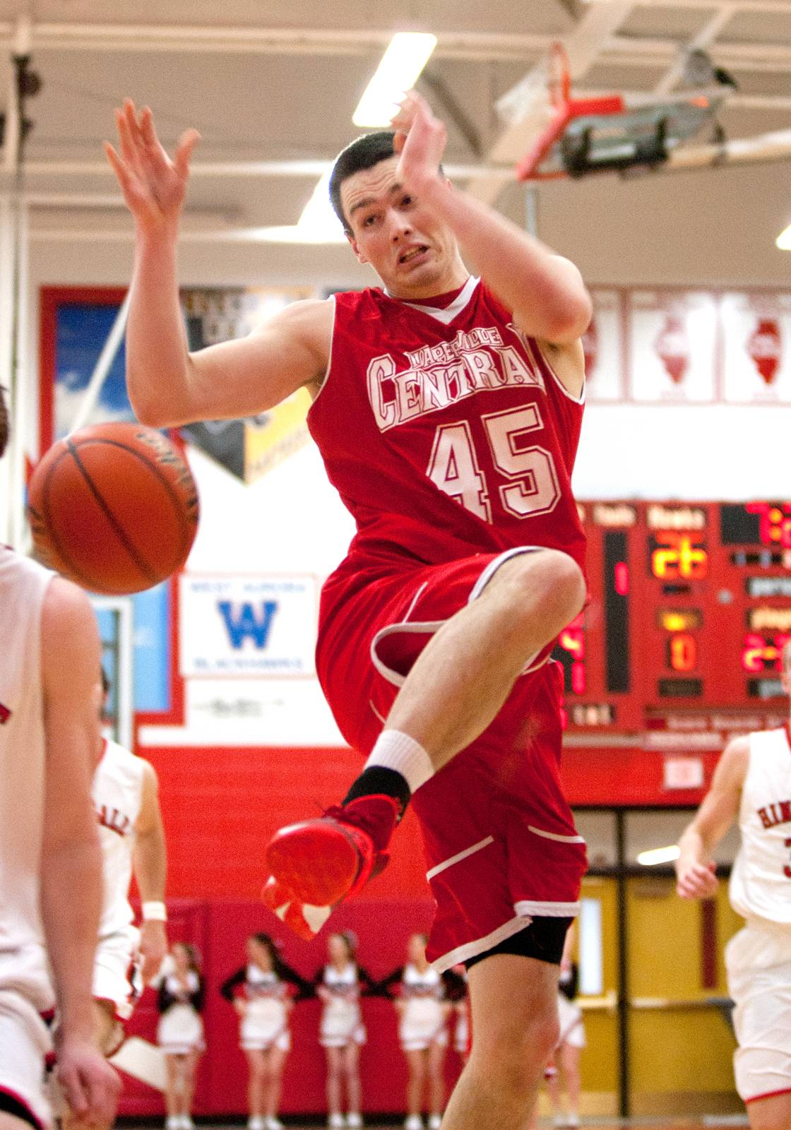 Naperville Central's Nick Czarnowski drives the lane against Hinsdale Central.