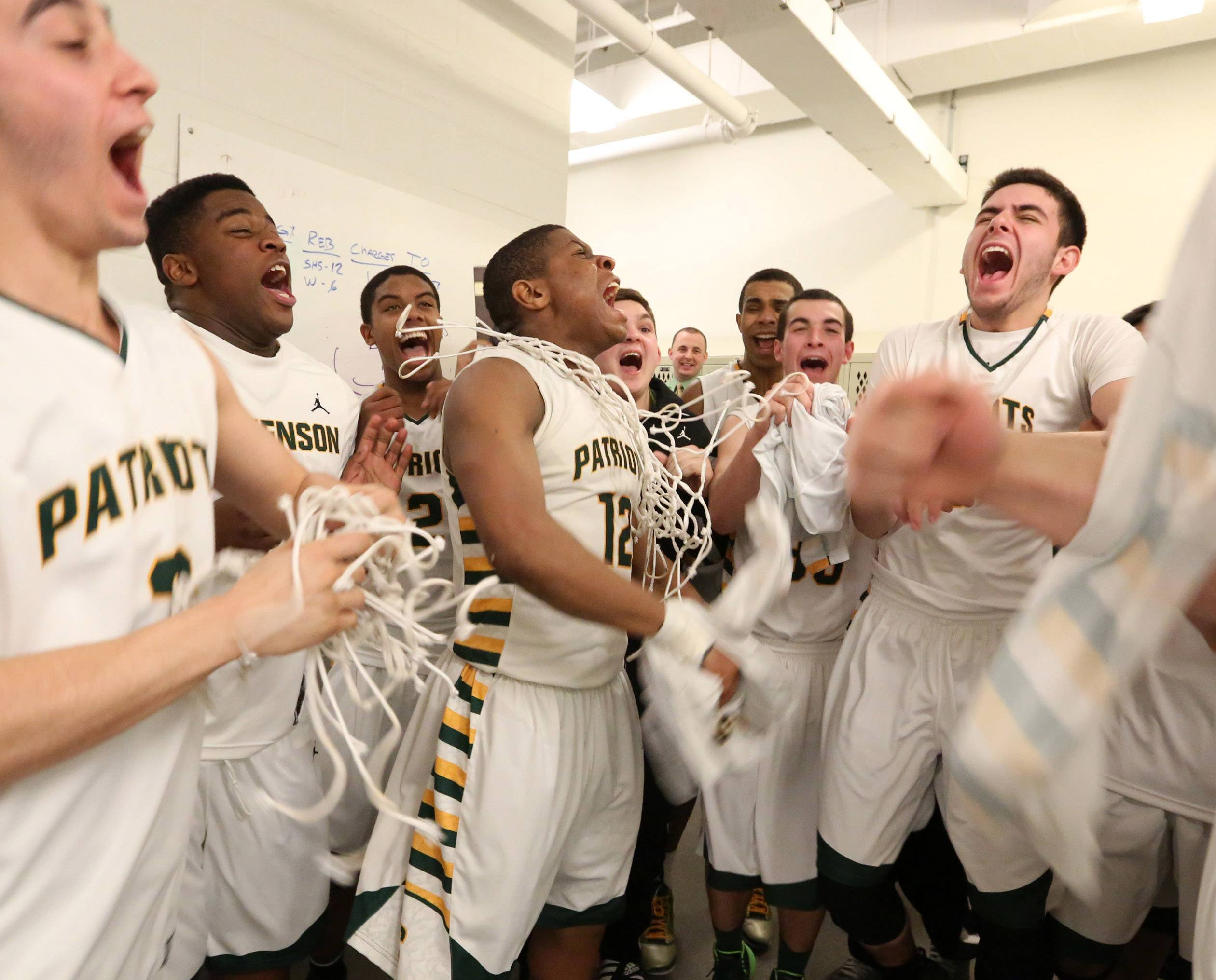 Stevenson players celebrate in the locker room after the game.