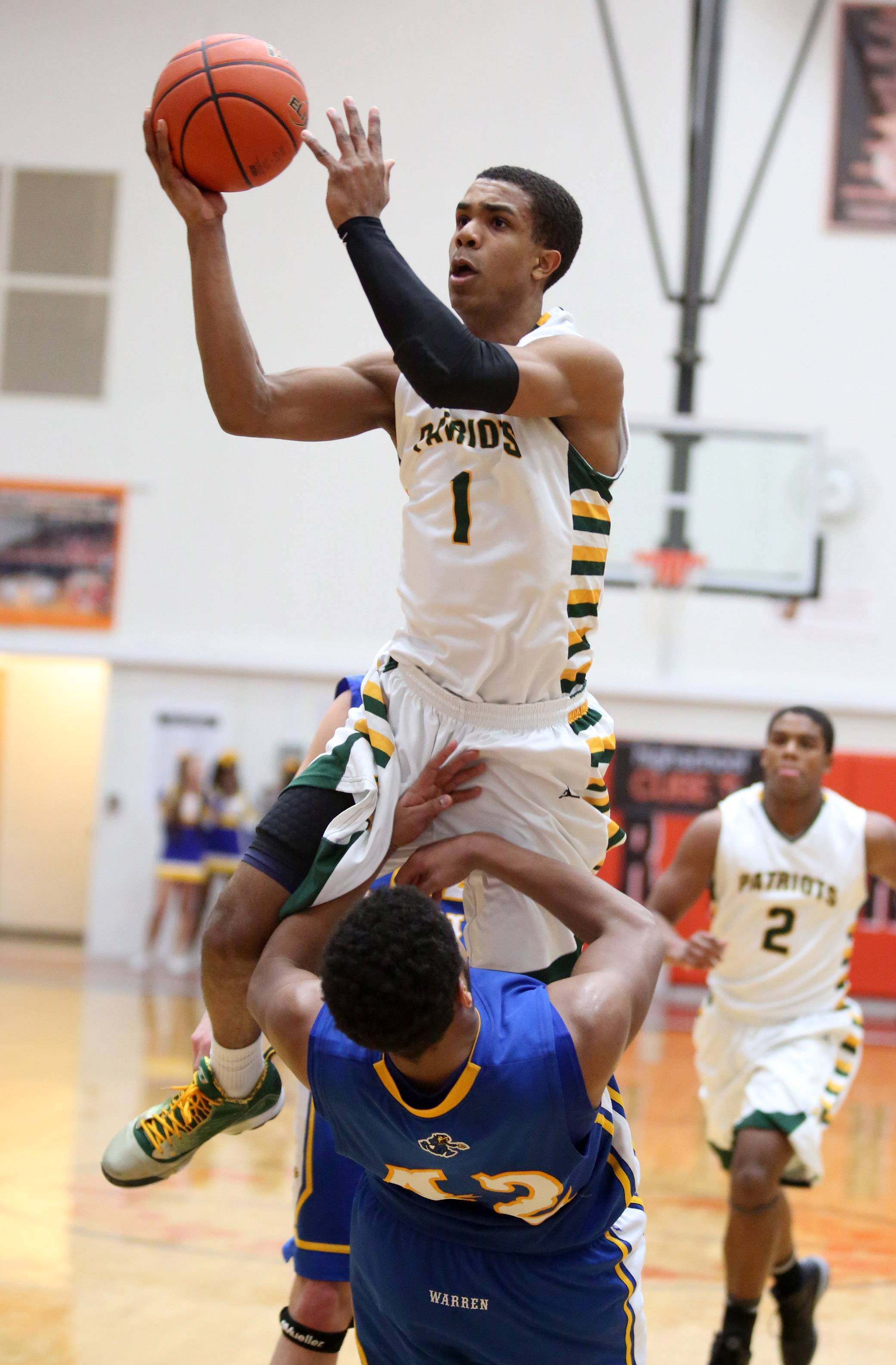 Stevenson guard Connor Cashaw shoots over Warren defender Caleb Reams .