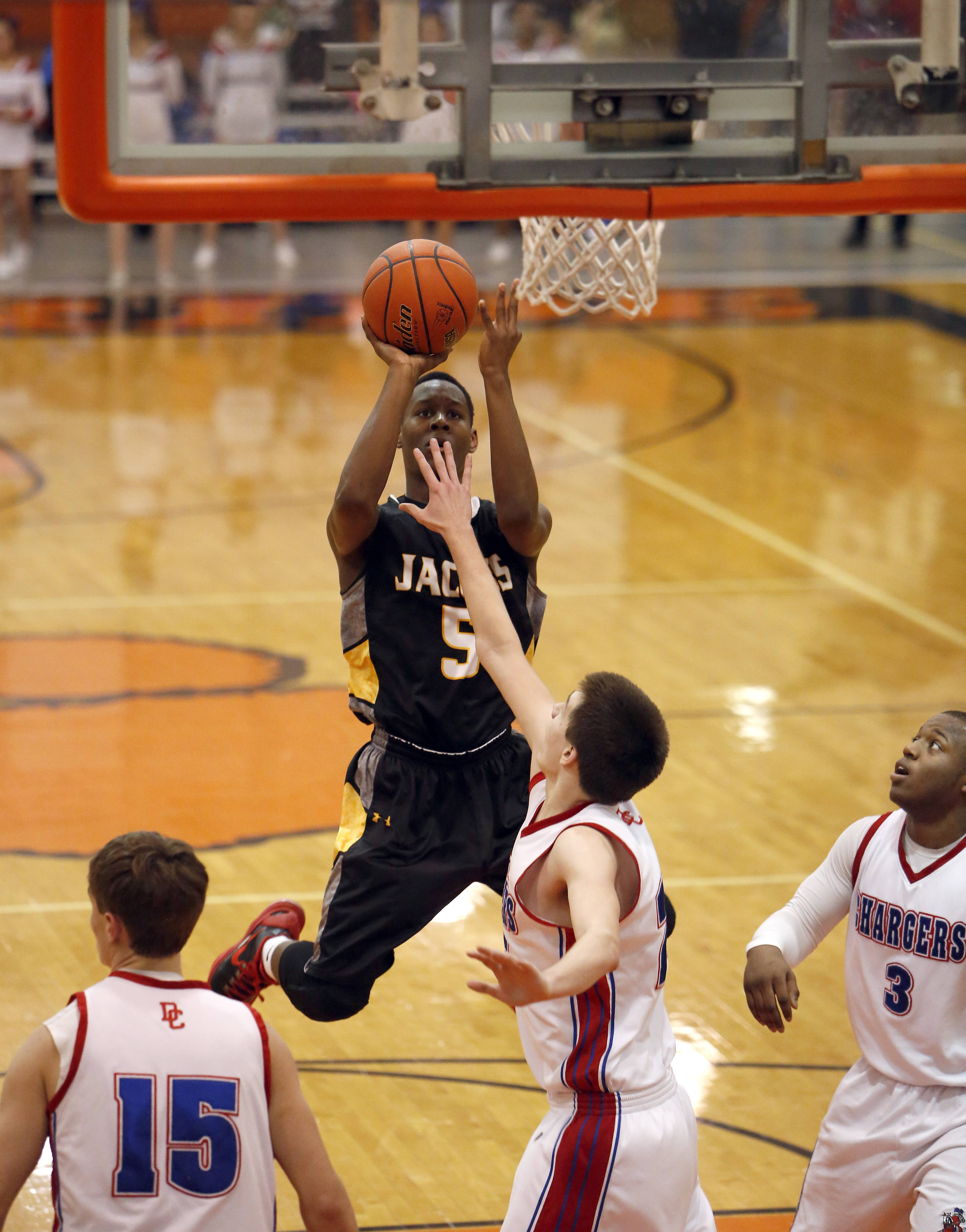 Jacobs' Chrishawn Orange goes to the basket during Class 4A regional championship action Friday at Crystal Lake Central.