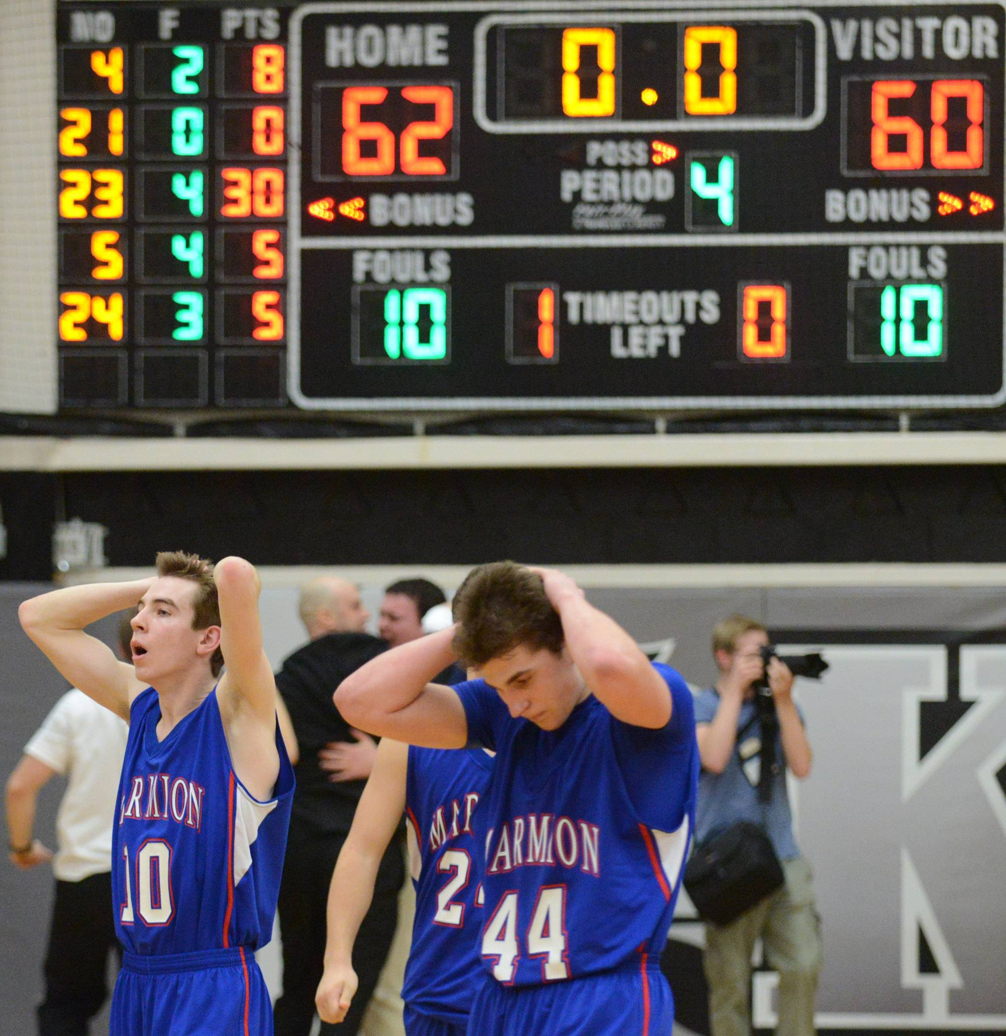 Marmion players, including Michael Sheehan and Danny Bicknell walk off the court after losing on a last-second shot.