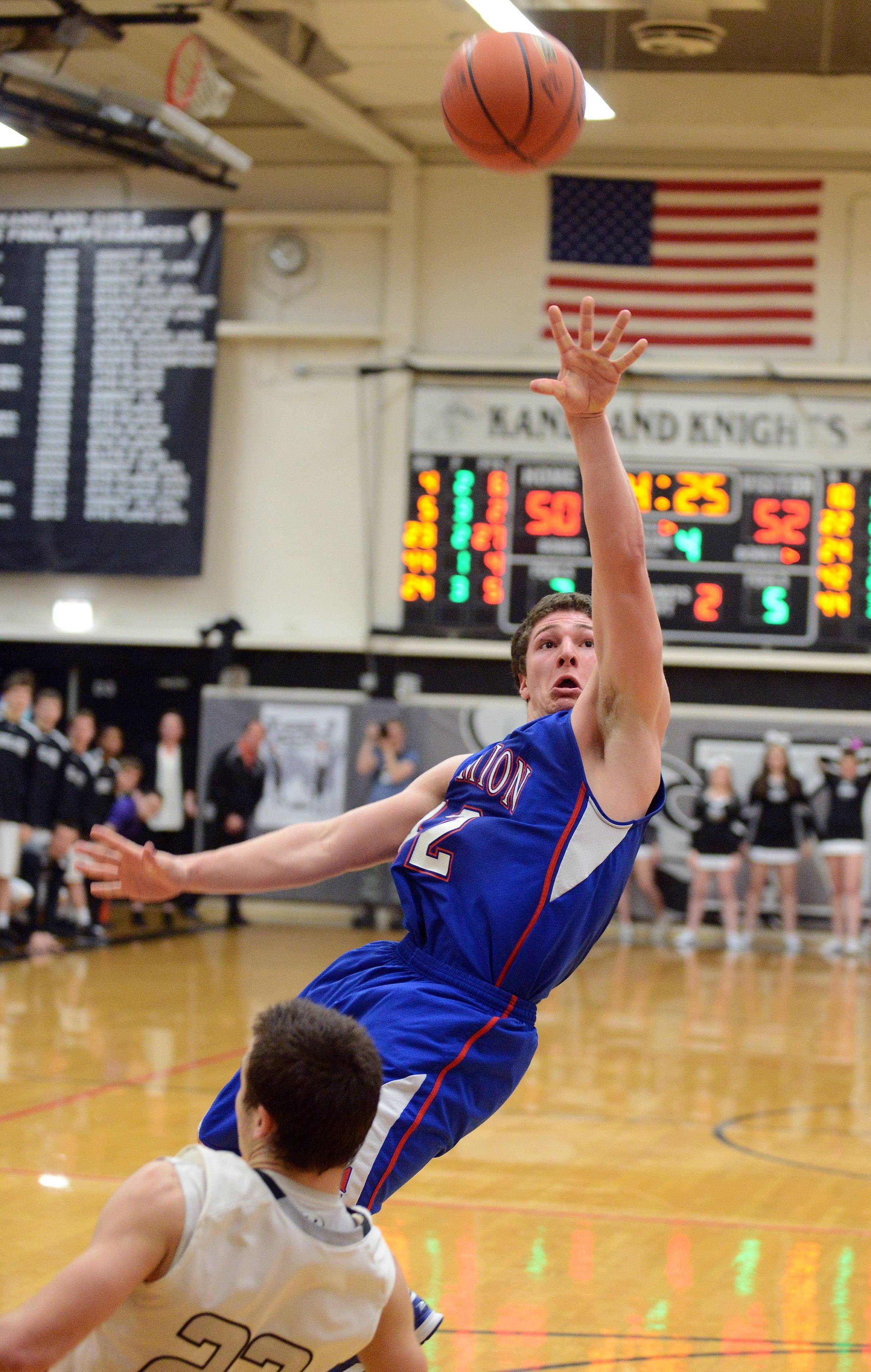 Marmion's Jordan Glasgow gets off an off-balance shot as he is fouled by Kaneland's Owen Korpela.