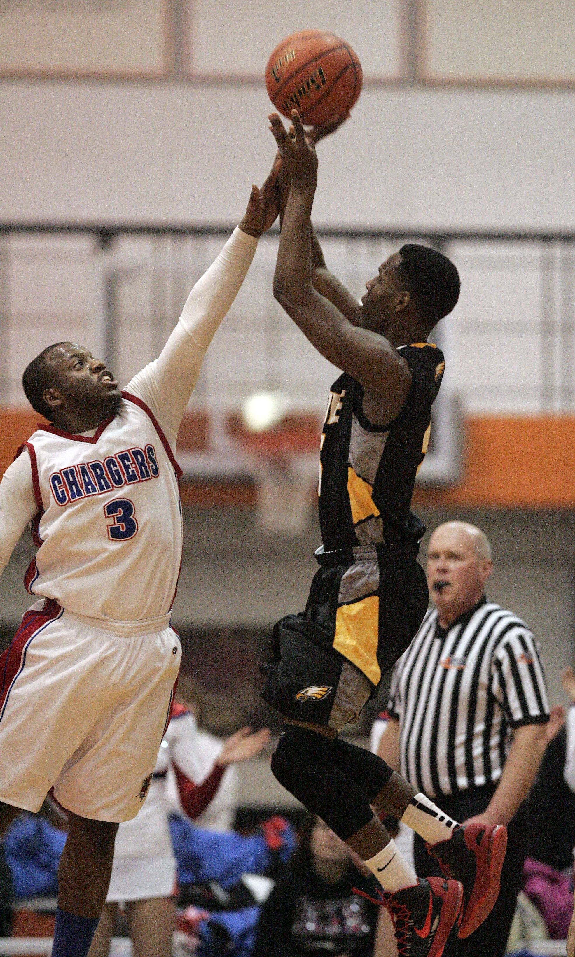 Jacobs' Chris Orange goes up and over Dundee-Crown's Cordero Parson .