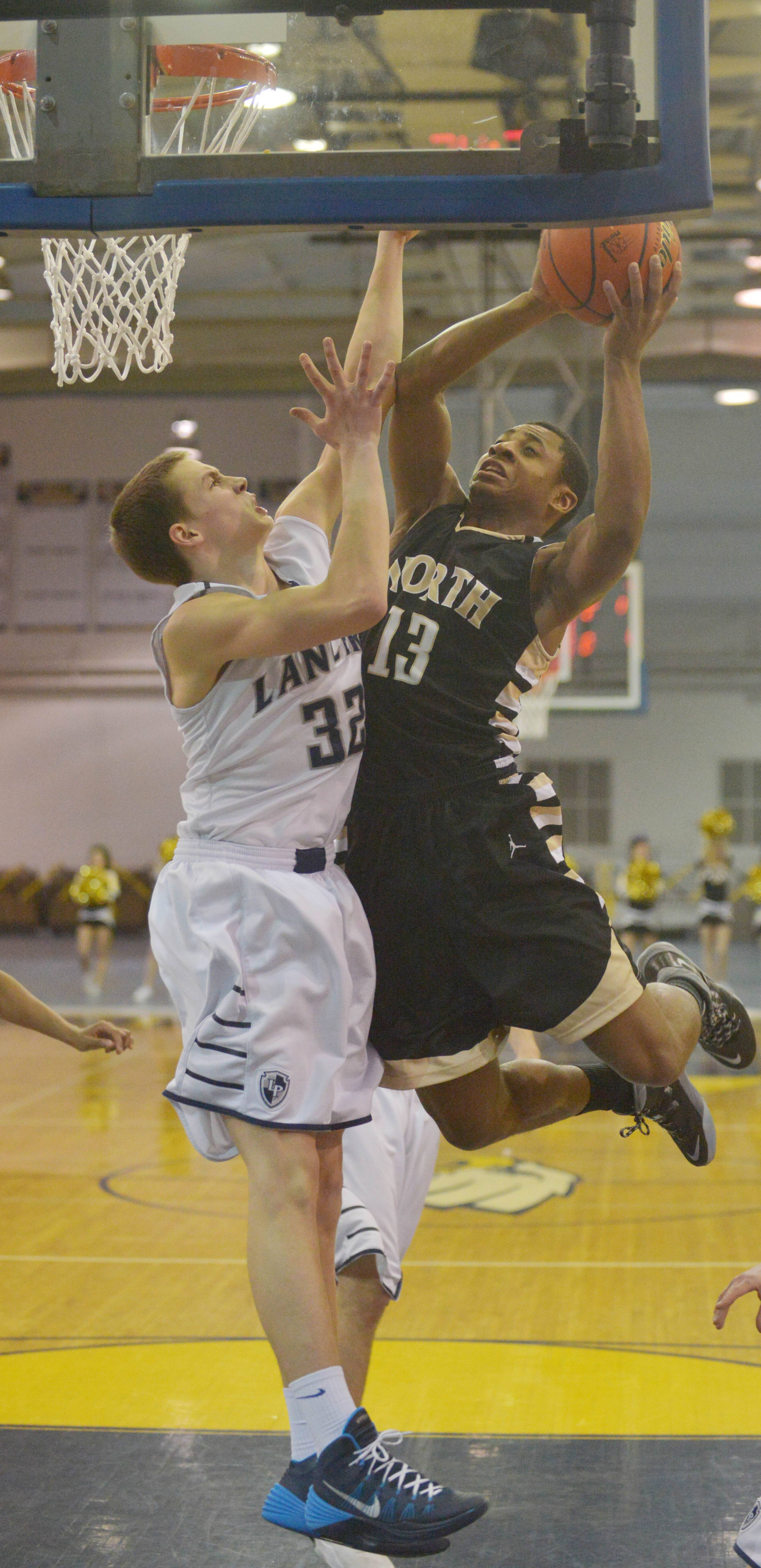 Conner Vance of Lake Park and Justin Jackson of Glenbard North go for the ball.