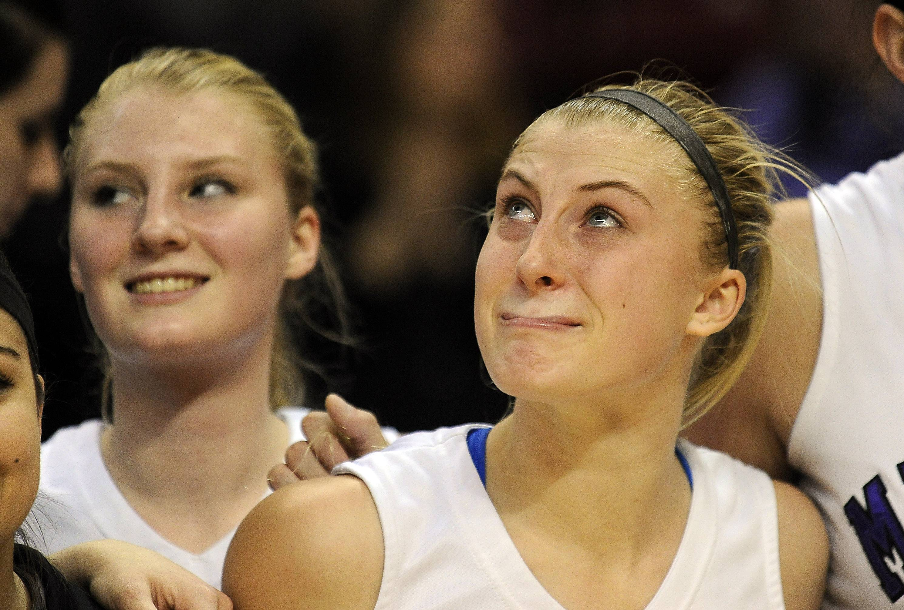 Rolling Meadows' Jackie Kemph feels the sting of a 60-44 loss to Whitney Young as she looks up at the scoreboard at the end of the Class 4A state championship game in Normal on Saturday.