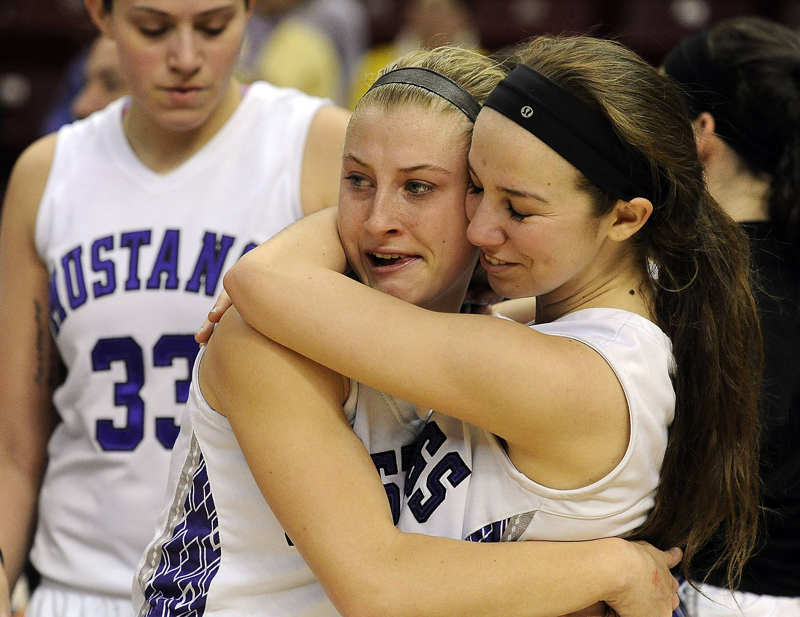 Rolling Meadows' Jackie Kemph and Sami Kay hug it out as their season comes to an end with a loss to Whitney Young in the Class 4A state championship game in Normal on Saturday.