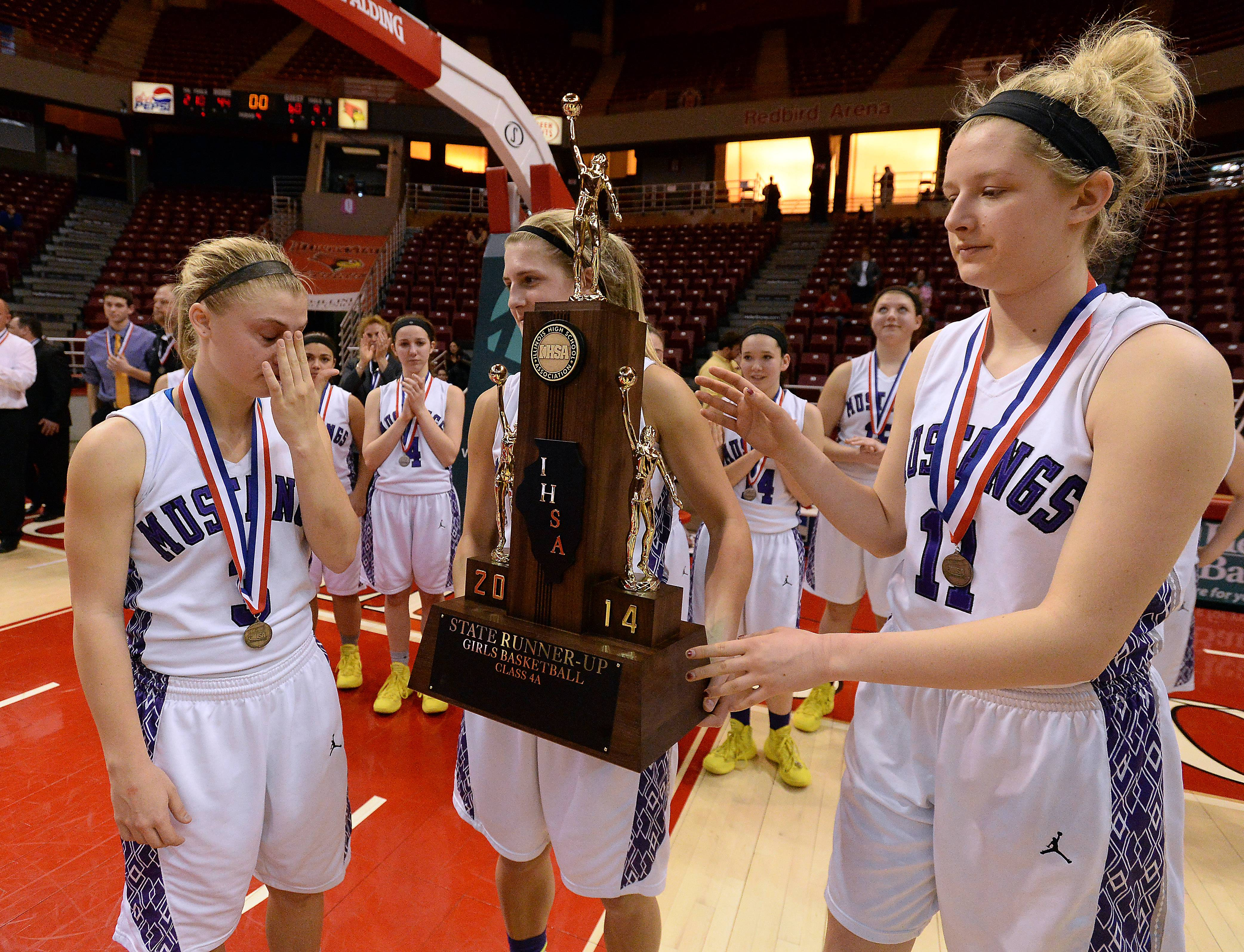 Rolling Meadows' Jackie Kemph, Alexis Glasgow and Jenny Vliet accept the Class 4A second-place trophy as their season comes to an end on Saturday in Normal.