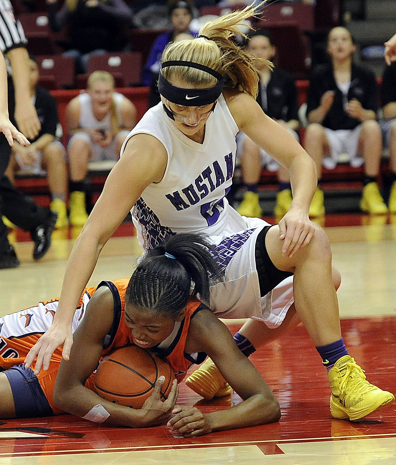 Rolling Meadows Alexis Glasgow battles for the ball with Chicago (Whitney Young) Kiara Lewis in the second half in the Class 4A girls basketball championship finals game in Normal on Saturday.
