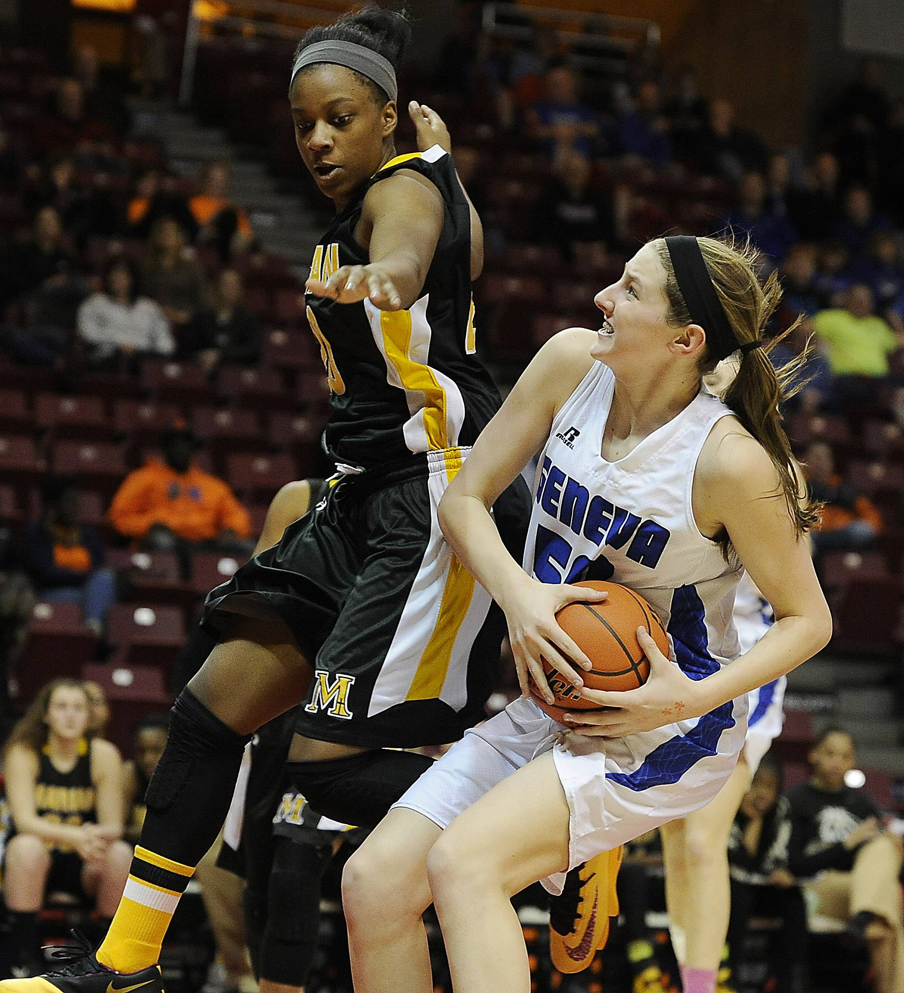 Geneva's Grace Loberg powers her way past Marian Catholic's Dajhae Mullins in the first half of the Class 4A third-place game in Normal on Saturday.