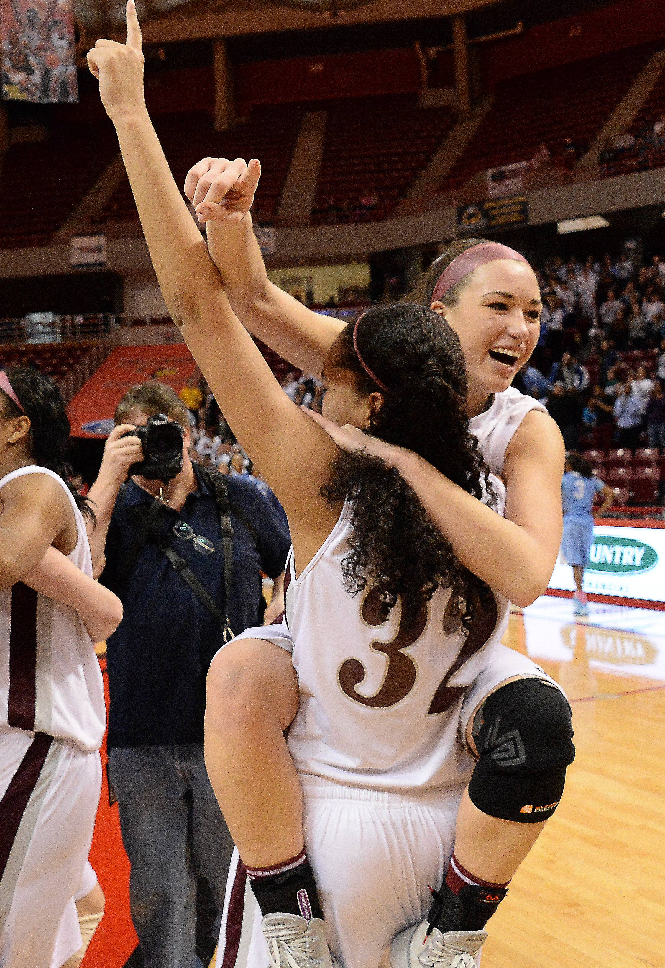 Montini's Kelsey Bogdan and Rainey Kuykendall celebrate their victory after beating Joliet Catholic in the Class 3A championship game in Normal on Saturday.