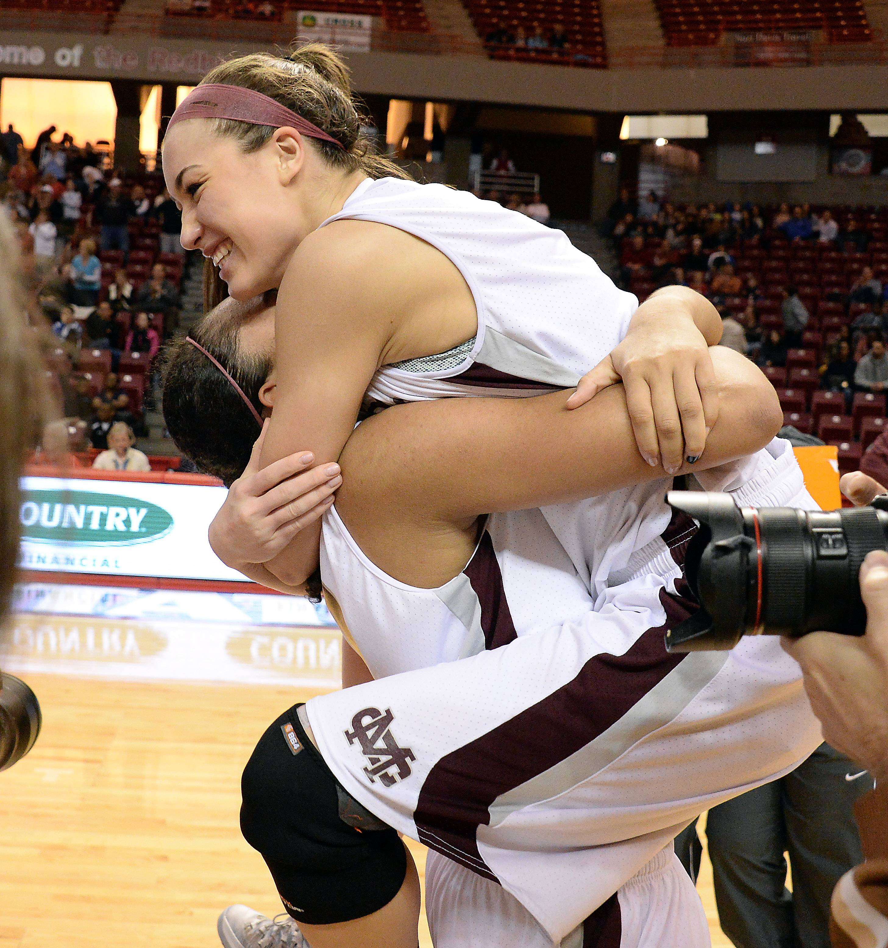 Mark Welsh/mwelsh@dailyherald.comMontini's Kelsey Bogdan and Rainey Kuykendall celebrate after beating Joliet Catholic in the Class 3A championship game in Normal on Saturday.