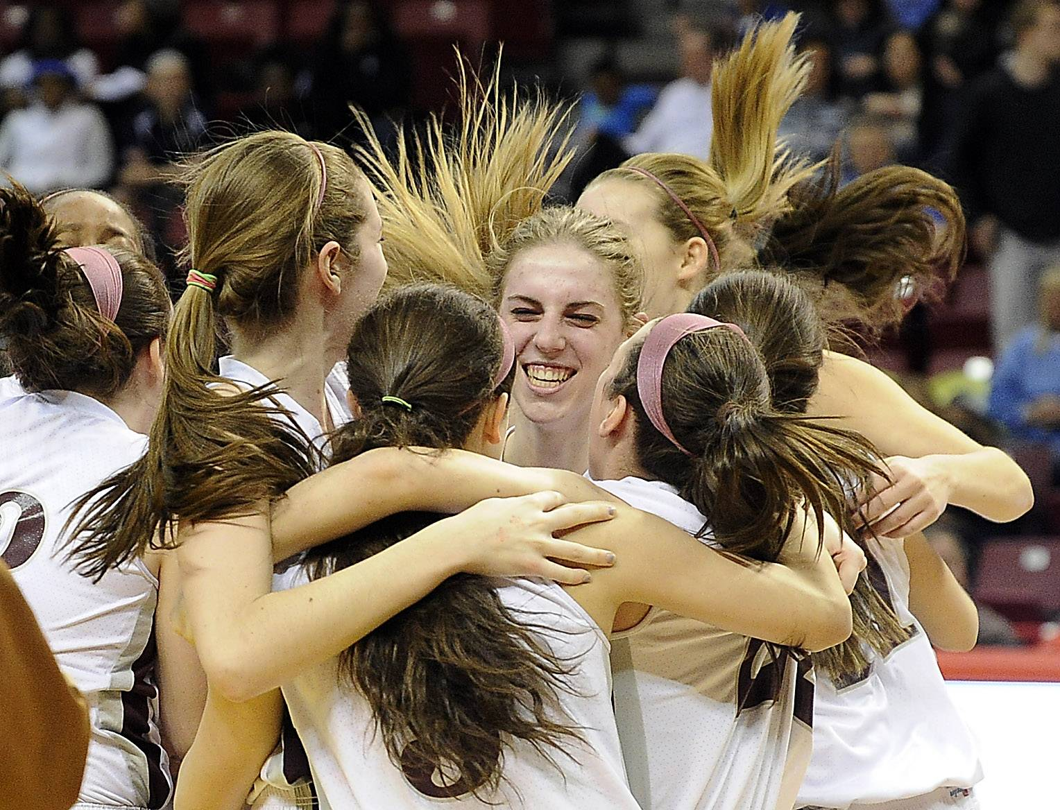 Montini's Kelly Karlis and her teammates celebrate their victory over Joliet Catholic in the Class 3A championship game in Normal on Saturday.