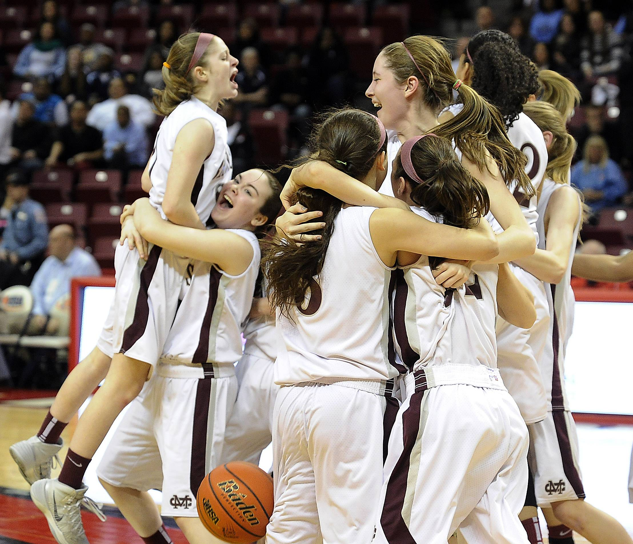 Kelly Karlis and Montini celebrate their victory after beating Joliet Catholic in the Class 3A championship game in Normal on Saturday.